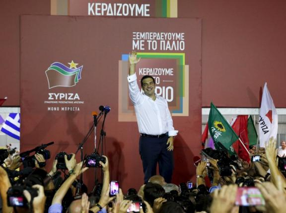 Former Greek prime minister and leader of leftist Syriza party Alexis Tsipras waves to supporters after winning the general election in Athens, Greece, September 20, 2015. Photo: Reuters