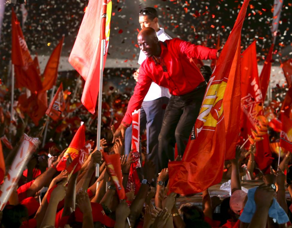 Keith Rowley (C), leader of the People's National Movement (PNM), greets supporters at a political rally at the Eddie Hart ground in Tacarigua, Trinidad, September 5, 2015. Photo: REUTERS