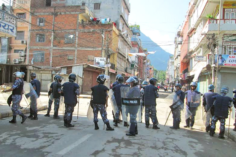 Standby security personnel in Damauli of Tanahun district on Sunday, September 13, 2015. Photo: Madan Wagle