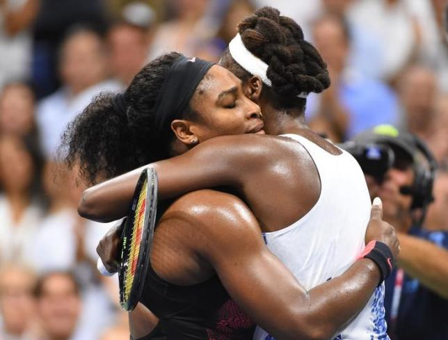 Sep 8, 2015; New York, NY, USA; Serena Williams of the USA (left) hugs sister Venus Williams of the USA after their match on day nine of the 2015 U.S. Open tennis tournament at USTA Billie Jean King National Tennis Center. Mandatory Credit: Robert Deutsch-USA TODAY Sports