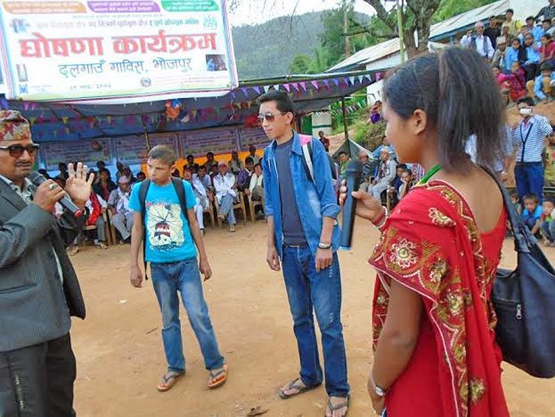 Artists performing a drama to make people aware in Dalgaun of Bhojpur district, on Saturday, September 19, 2015. Photo: Niroj Koirala