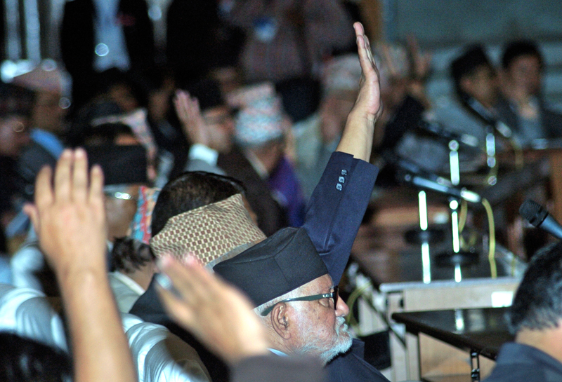 Prime Minister Sushil Koirala participating in voting on individual articles of the new constitution and amendment proposals, in CA Hall, on Monday. Photo: Dhurba Ale/ THT