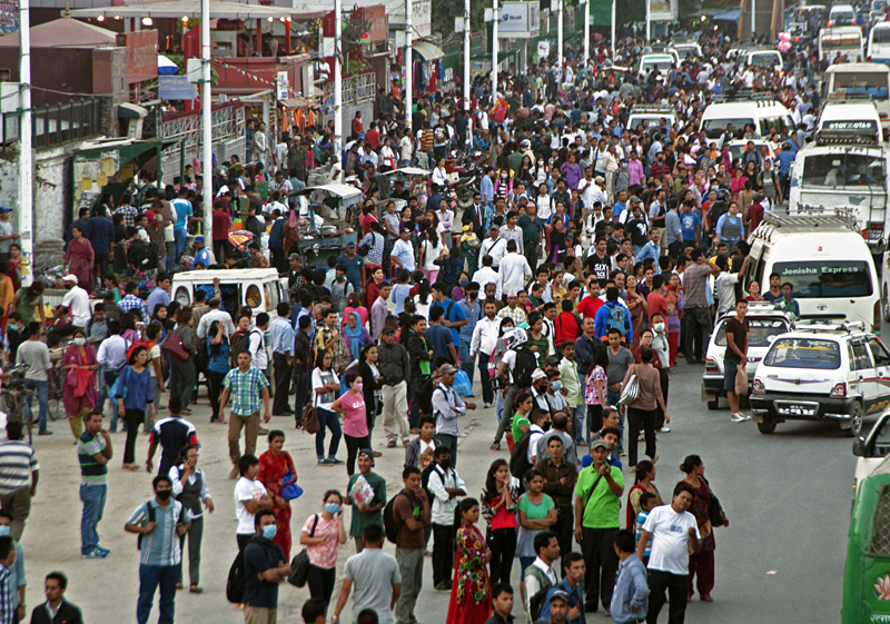 Commuters waiting for public vehicles at Sundhara, Kathmandu, on Thursday. Only few public vehicles operated in the capital due to the fuel shortage. Photo: THT