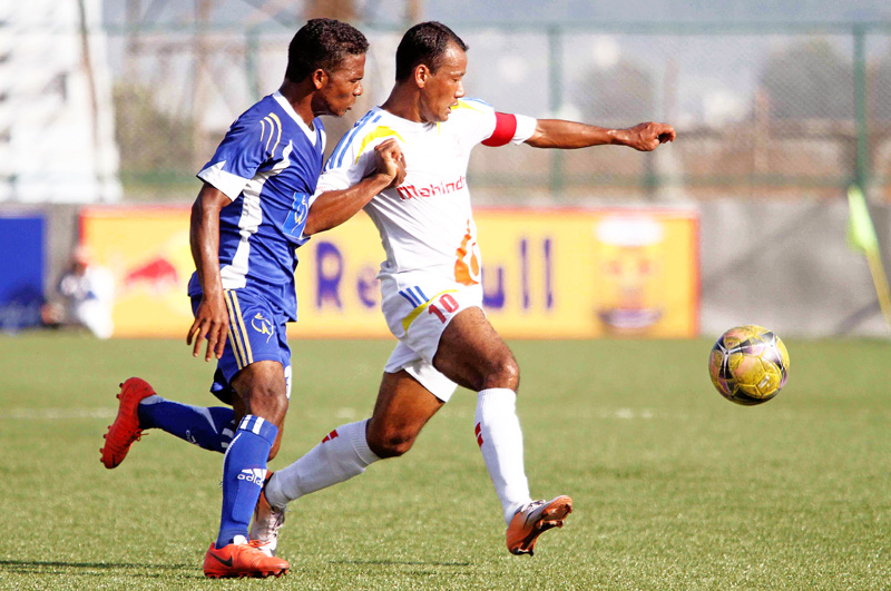 Ganesh Lawati (right) skipper of APF Club vies for the ball against Santosh Hemroon of Nepal Police Club during their Red Bull National League match at ANFA Complex in Lalitpur on Friday. (Credit Image: Udipt Singh Chhetry)