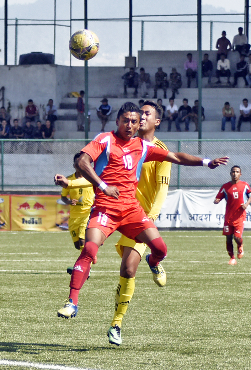 TAC's Nawayug Shrestha (front) and Morang's Manish Ghale vie for the ball during their Red Bull National League match at the ANFA Complex grounds in Lalitpur on Sunday, October 04, 2015. Photo: THT