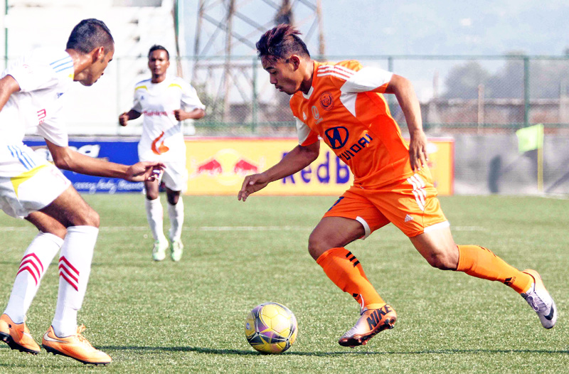 Dipak Rai (right) of Manang Marsyangdi Club dribbles the ball against APF player during their Red Bull National League match at ANFA Complex in Lalitpur on Monday. (Credit Image: Udipt Singh Chhetry)