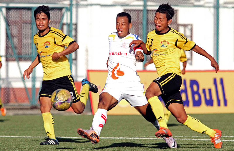 Ganesh Lawati (center) skipper of Nepal APF Club vies for the ball against players of Lumbini Football Club during their Red Bull National League match at ANFA Complex in Lalitpur on Thursday. (Credit Image: Udipt Singh Chhetry)