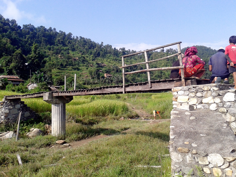 A wooden bridge with broken railing over the Payar Khola stream in Byas Muncipality in Tanahun district on Saturday, October 17, 2015. Photo: Madan Wagle