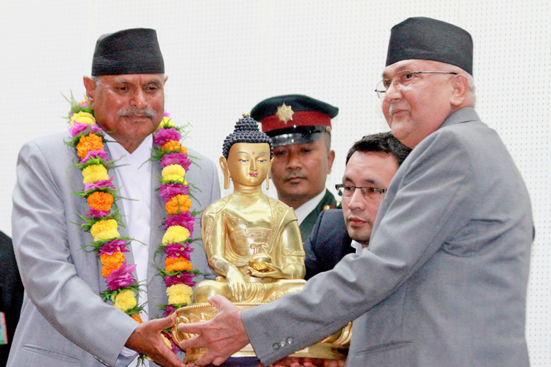 PM KP Sharma Oli presents a Gautam Buddha memento to the outgoing President Ram Baran Yadav at Sheetal Newas on Thursday, October 29, 2015. Photo: RSS