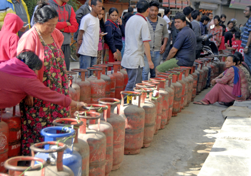 Customers waiting in queue to get the half filled LPG cylinders in Kathamandu. Photo: THT