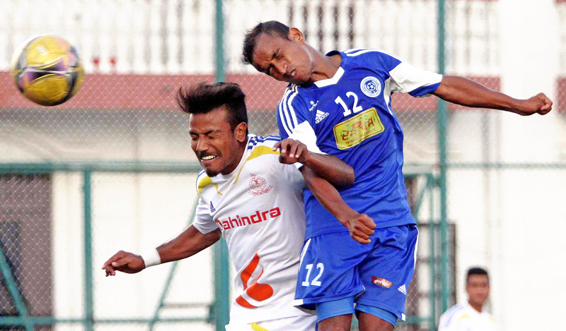 Dinesh Karki (right) of Jhapa Xi and Sudeep Sikhrakar of Nepal APF Club vie for a header during their Red Bull National League match at ANFA Complex in Lalitpur on Thursday. (Credit Image: Udipt Singh Chhetry)