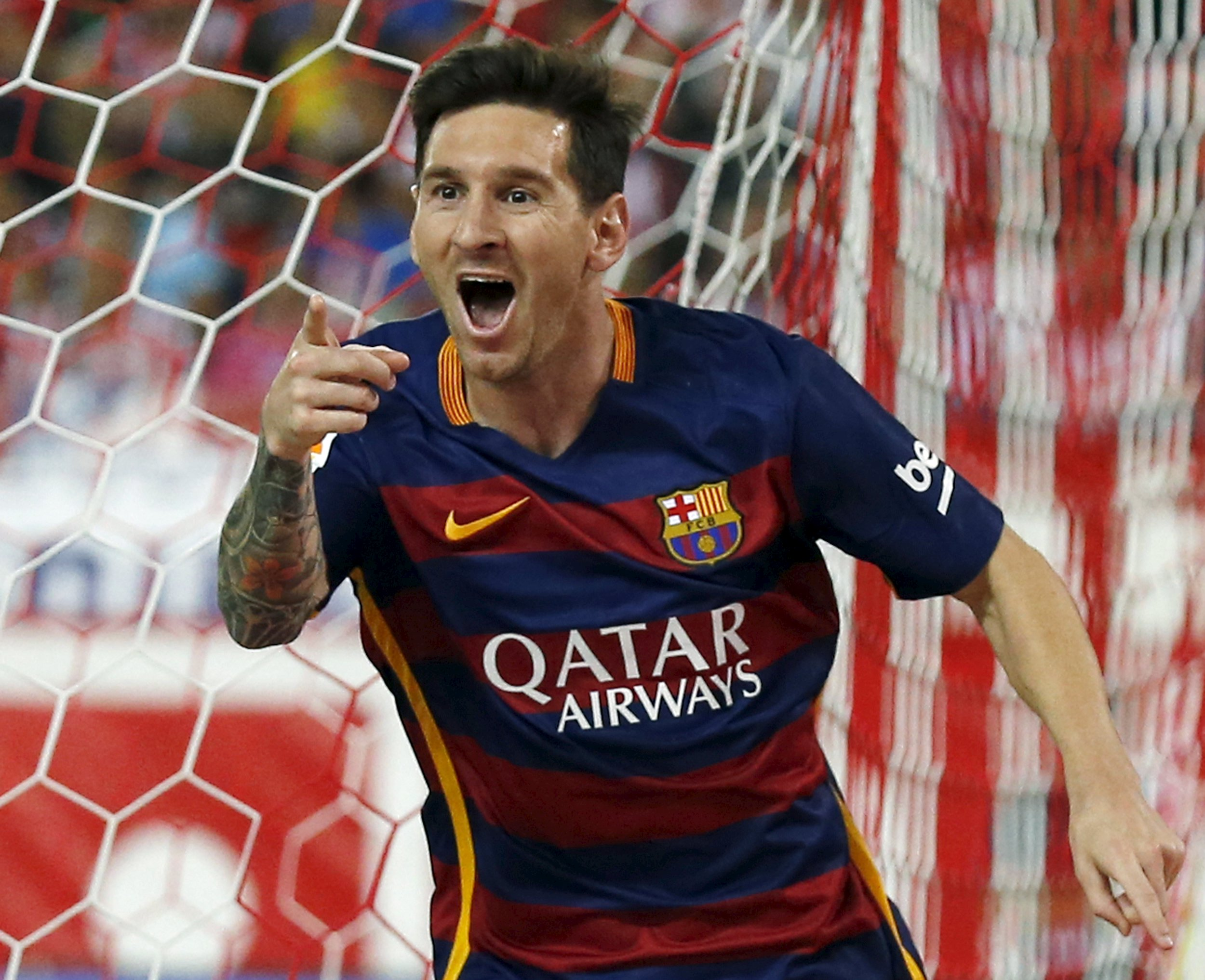 Barcelona's Lionel Messi celebrates after scoring a goal against Atletico Madrid's during their Spanish first division soccer match at Vicente Calderon stadium in Madrid, September 12, 2015. REUTERS/Javier Barbancho