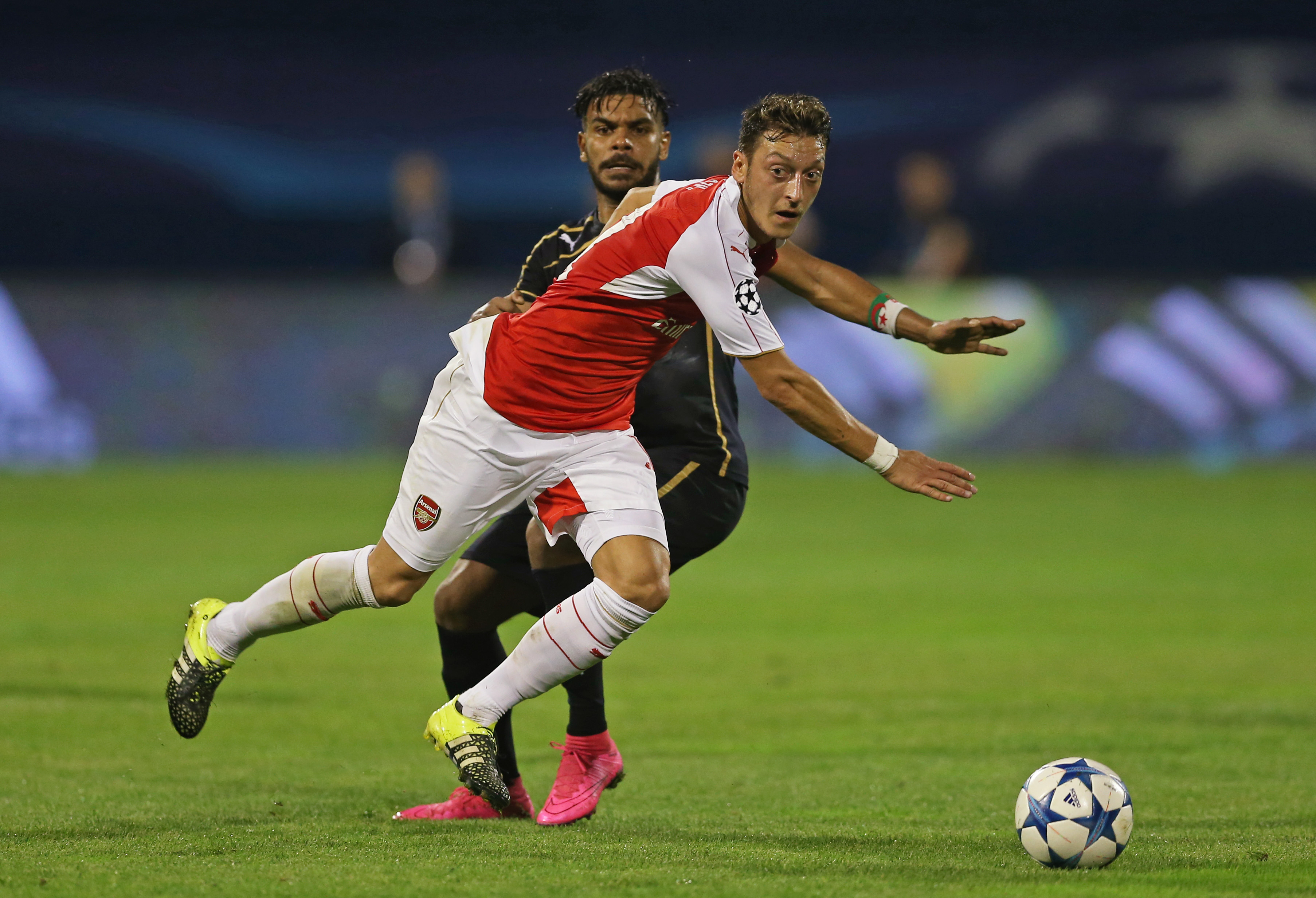 Football - Dinamo Zagreb v Arsenal - UEFA Champions League Group Stage - Group F - Maksimir Stadium, Zagreb, Croatia - 16/9/15nArsenal's Mesut Ozil in action with Zagreb's El Arabi Hilal SoudaninAction Images via Reuters / Matthew ChildsnLivepicnEDITORIAL USE ONLY.