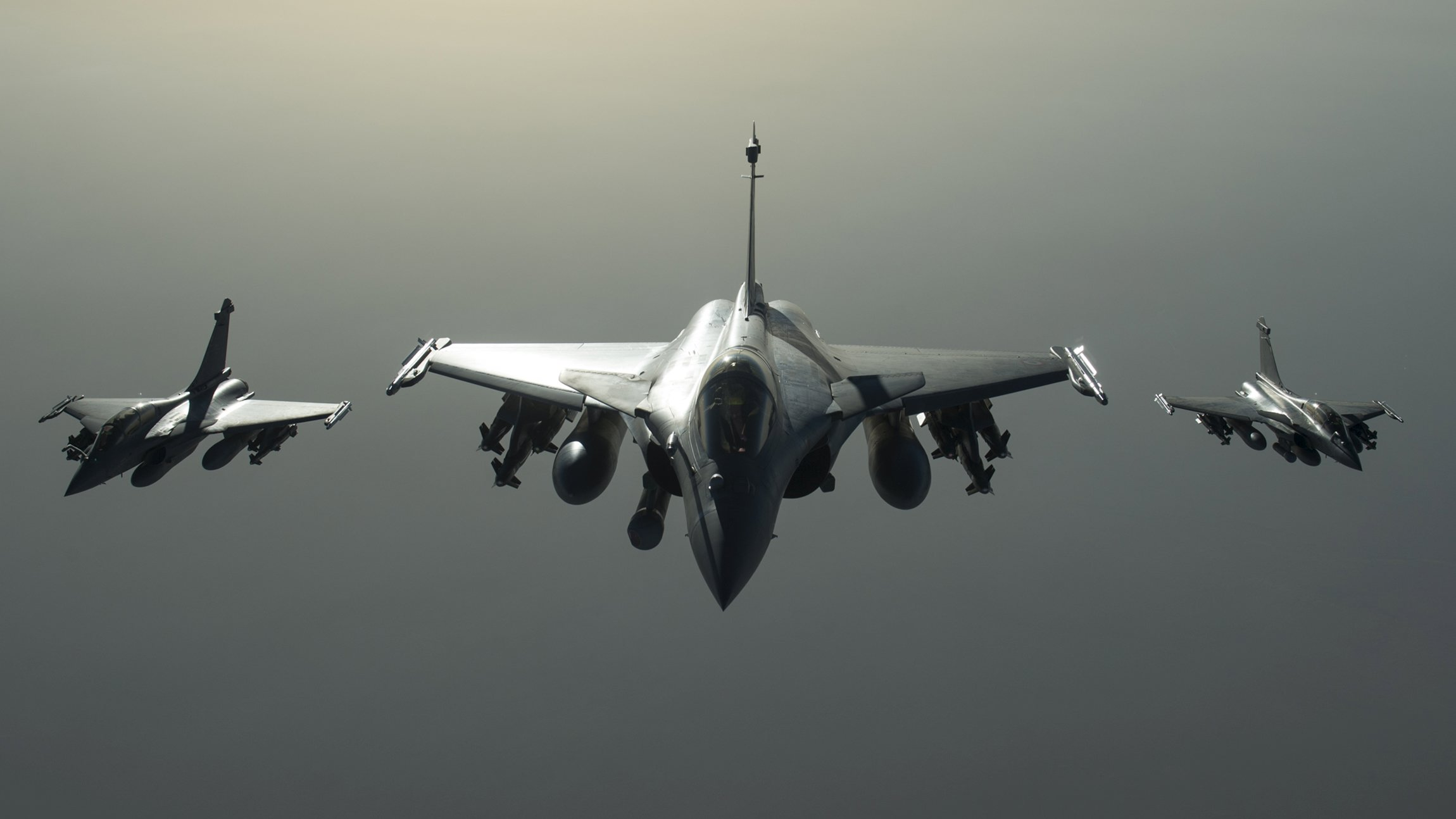 French Army Rafale fighter jets are seen in flight during an operation against Syria, in this handout photo distributed by the French Defense Audiovisial Communication and Production Unit (ECPAD) and realeased September 27, 2015. France said on Sunday it launched its first air strikes in Syria, destroying an Islamic State training camp in the east of the country to prevent the group from carrying out attacks against French interests and to protect Syrian civilians. The French Presisent said from New York that six fighter jets had destroyed their targets near Deir ez-Zor and that more operations could take place in coming weeks to protect France and Syrian civilians.     REUTERS/ECPAD/Handout     FOR EDITORIAL USE ONLY. NOT FOR SALE FOR MARKETING OR ADVERTISING CAMPAIGNS THIS IMAGE HAS BEEN SUPPLIED BY A THIRD PARTY. IT IS DISTRIBUTED, EXACTLY AS RECEIVED BY REUTERS, AS A SERVICE TO CLIENTS NO SALES