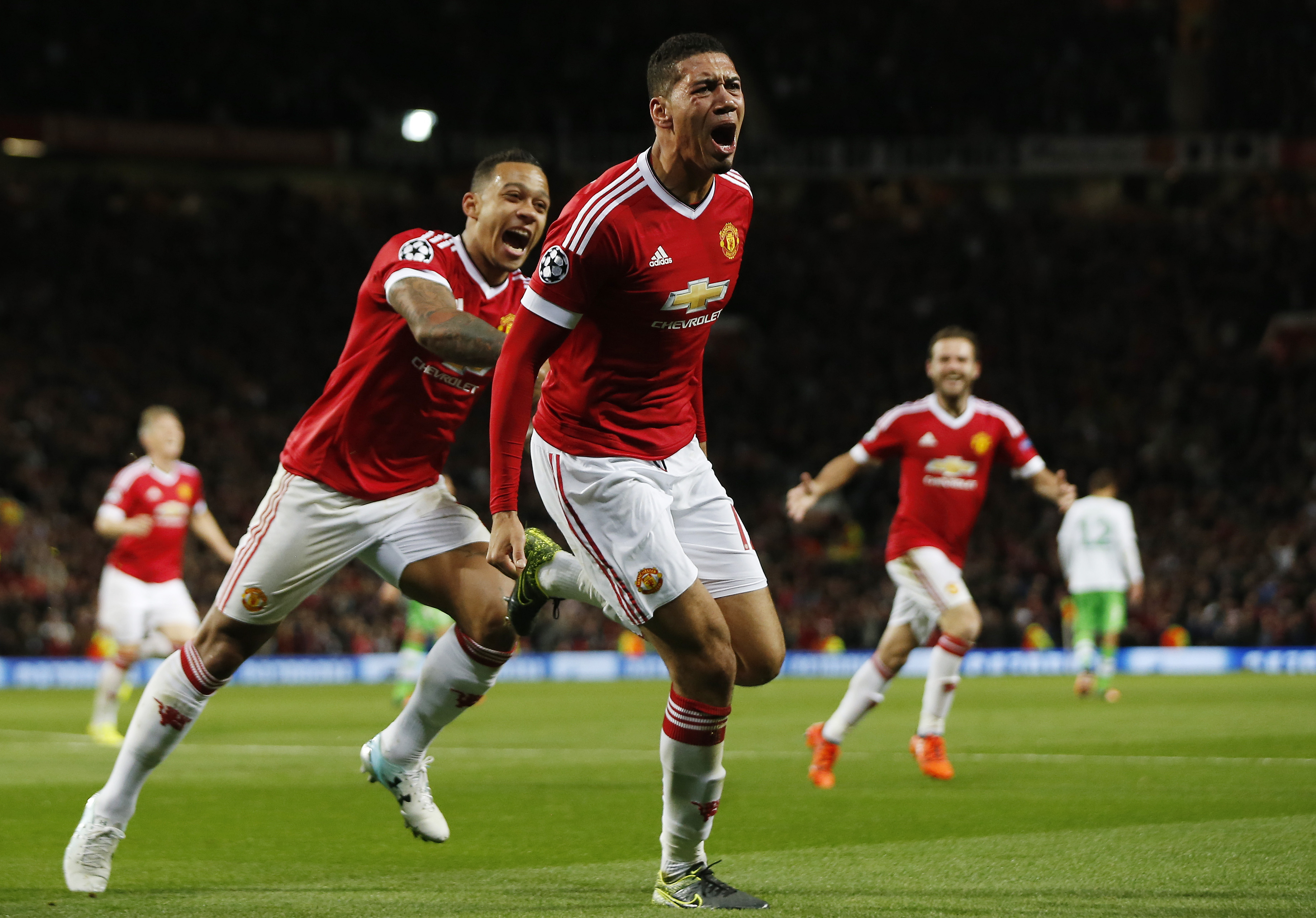 Football - Manchester United v VfL Wolfsburg - UEFA Champions League Group Stage - Group B - Old Trafford, Manchester, England - 30/9/15nChris Smalling celebrates scoring the second goal for Manchester United nAction Images via Reuters / Lee SmithnLivepicnEDITORIAL USE ONLY.