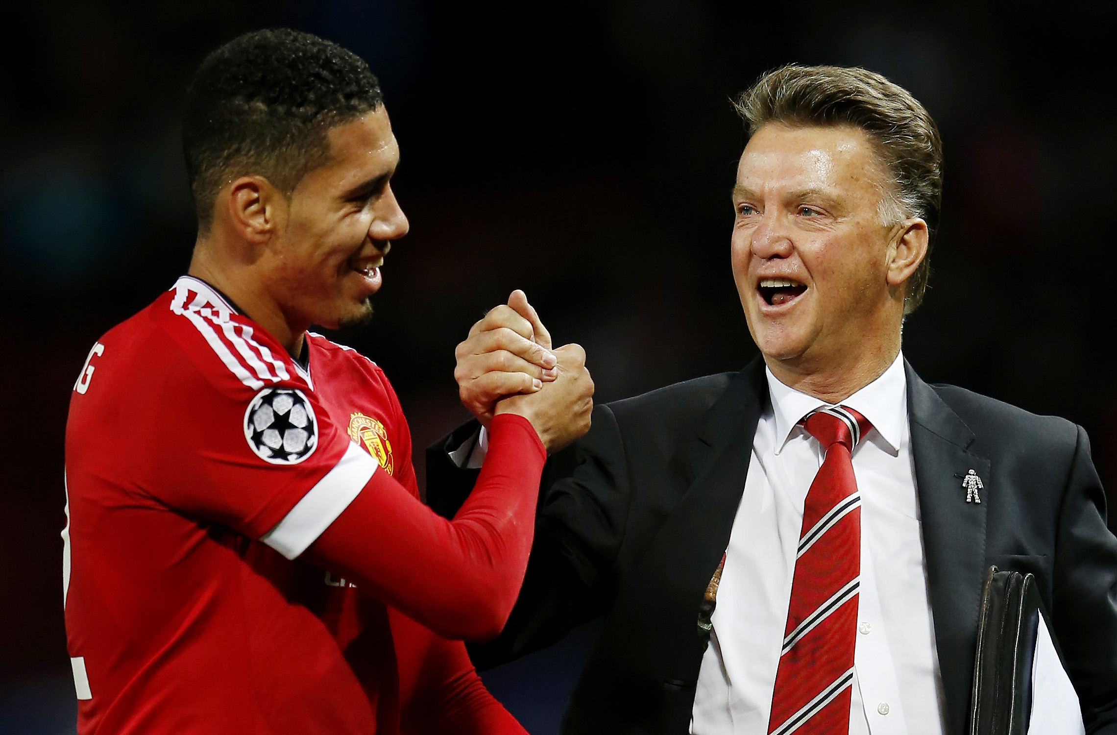 Football - Manchester United v VfL Wolfsburg - UEFA Champions League Group Stage - Group B - Old Trafford, Manchester, England - 30/9/15nManchester United's Chris Smalling celebrates with manager Louis van Gaal after the gamenAction Images via Reuters / Lee SmithnLivepicnEDITORIAL USE ONLY.