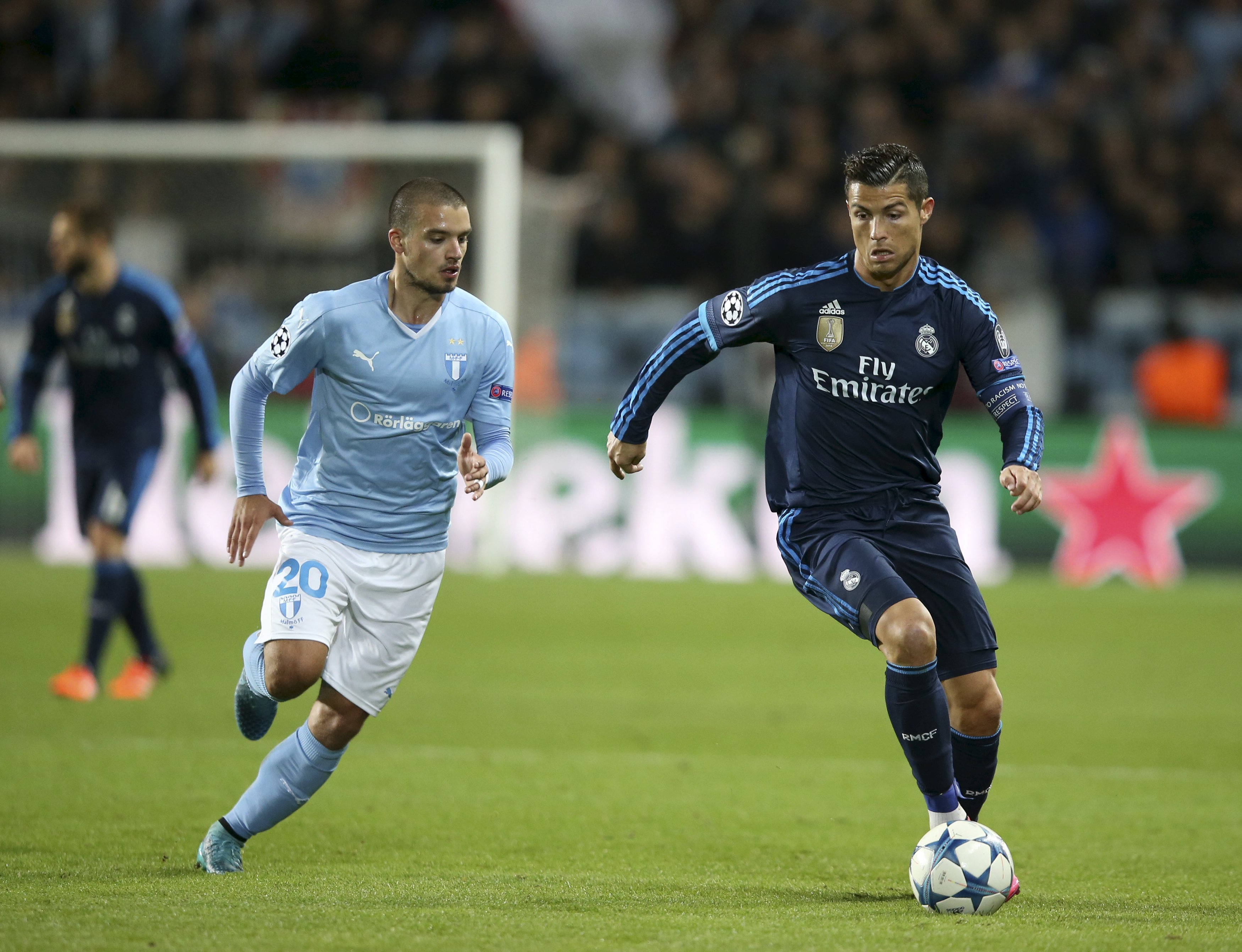Malmo FF's Vladimir Rodic (L) challenges Real Madrid's Cristiano Ronaldo during their Champions League group A soccer match at Malmo New Stadium in Malmo, Sweden September 30, 2015. REUTERS/Andreas Hillergren/TT News Agency  ATTENTION EDITORS - THIS IMAGE WAS PROVIDED BY A THIRD PARTY. THIS PICTURE IS DISTRIBUTED EXACTLY AS RECEIVED BY REUTERS, AS A SERVICE TO CLIENTS. FOR EDITORIAL USE ONLY. NOT FOR SALE FOR MARKETING OR ADVERTISING CAMPAIGNS. SWEDEN OUT. NO COMMERCIAL OR EDITORIAL SALES IN SWEDEN. NO COMMERCIAL SALES.