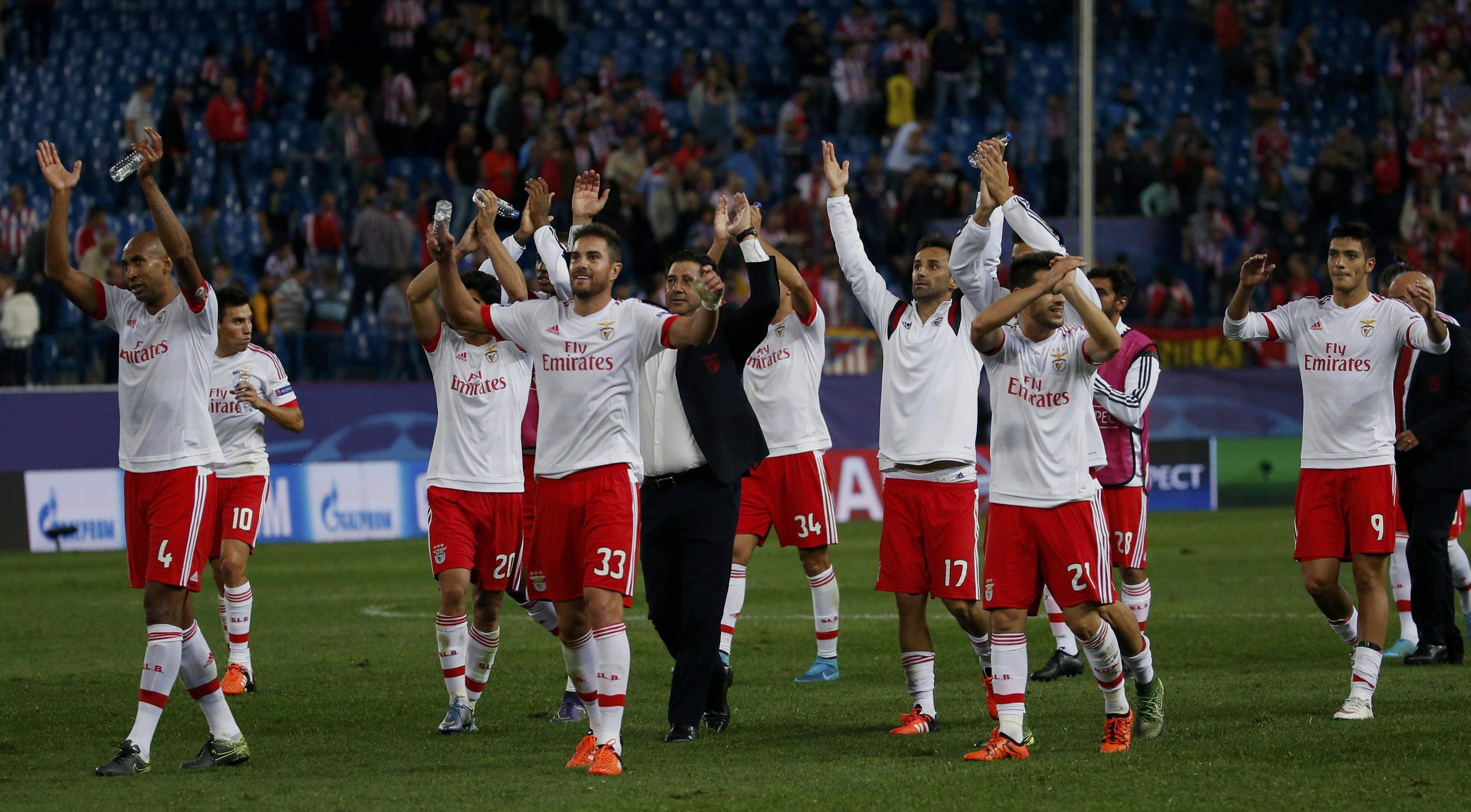 Benfica's players celebrate victory over Atletico Madrid at the end of their Champions League group C soccer match at Vicente Calderon stadium in Madrid, Spain, September 30, 2015. REUTERS/Juan Medina