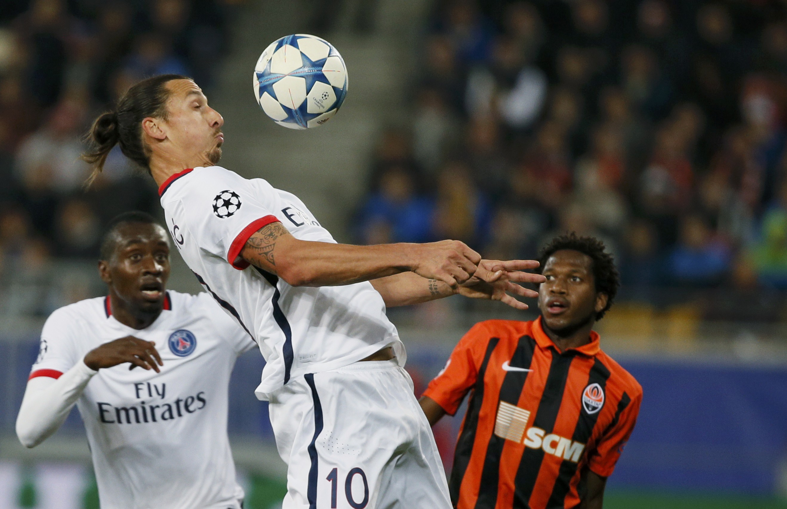 Paris St Germain's Zlatan Ibrahimovic (C) jumps for the ball past his team mate Blaise Matuidi (L) and Shakhtar Donetsk's Fred during their Champions League group A soccer match at the Arena Lviv stadium in Lviv, Ukraine, September 30, 2015. REUTERS/Gleb Garanich