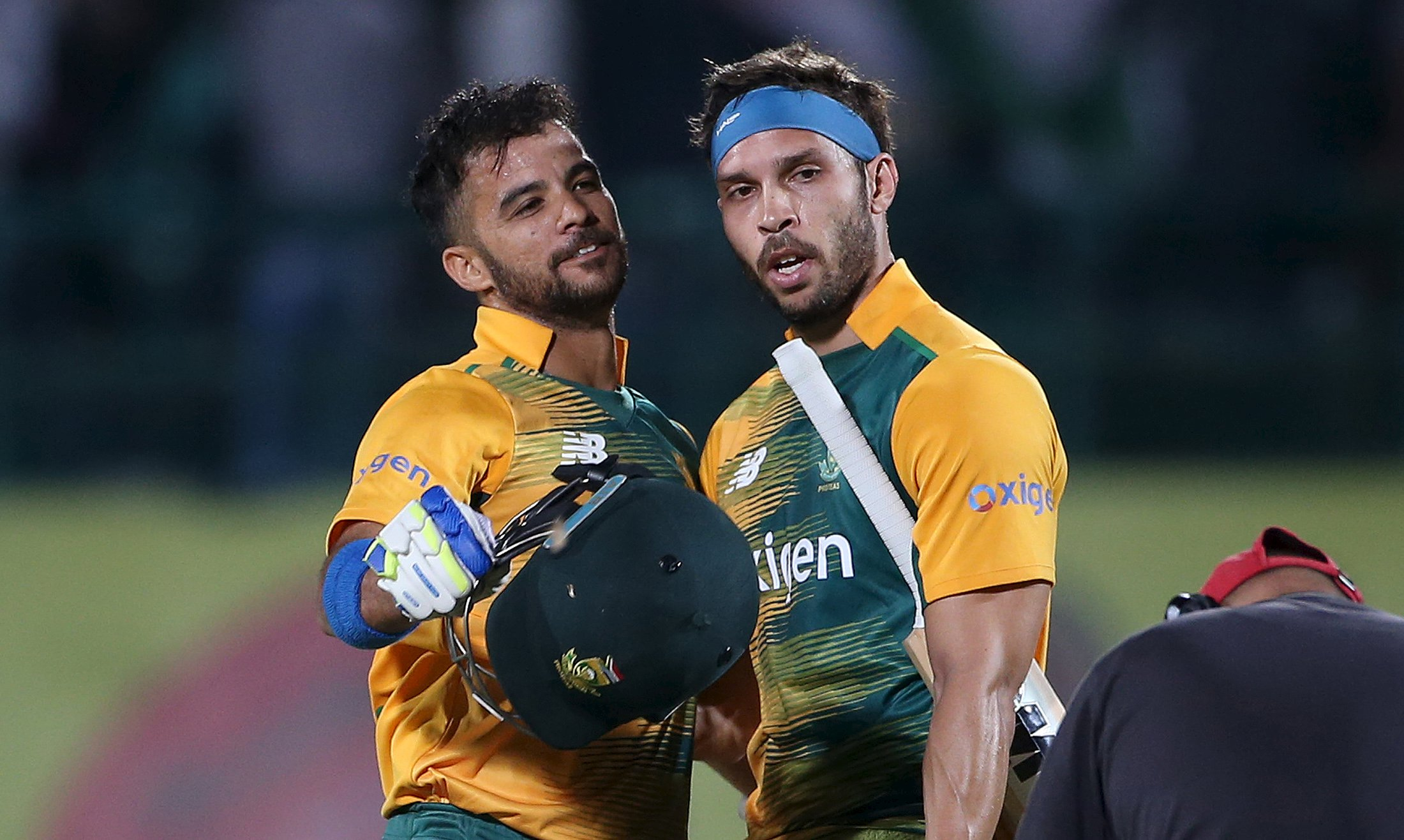 South Africa's Farhaan Behardien (R) and Jean-Paul Duminy celebrate their team's victory over India during their first Twenty-20 cricket match in the northern Indian hill town of Dharamsala, India, October 2, 2015. REUTERS/Adnan Abidi