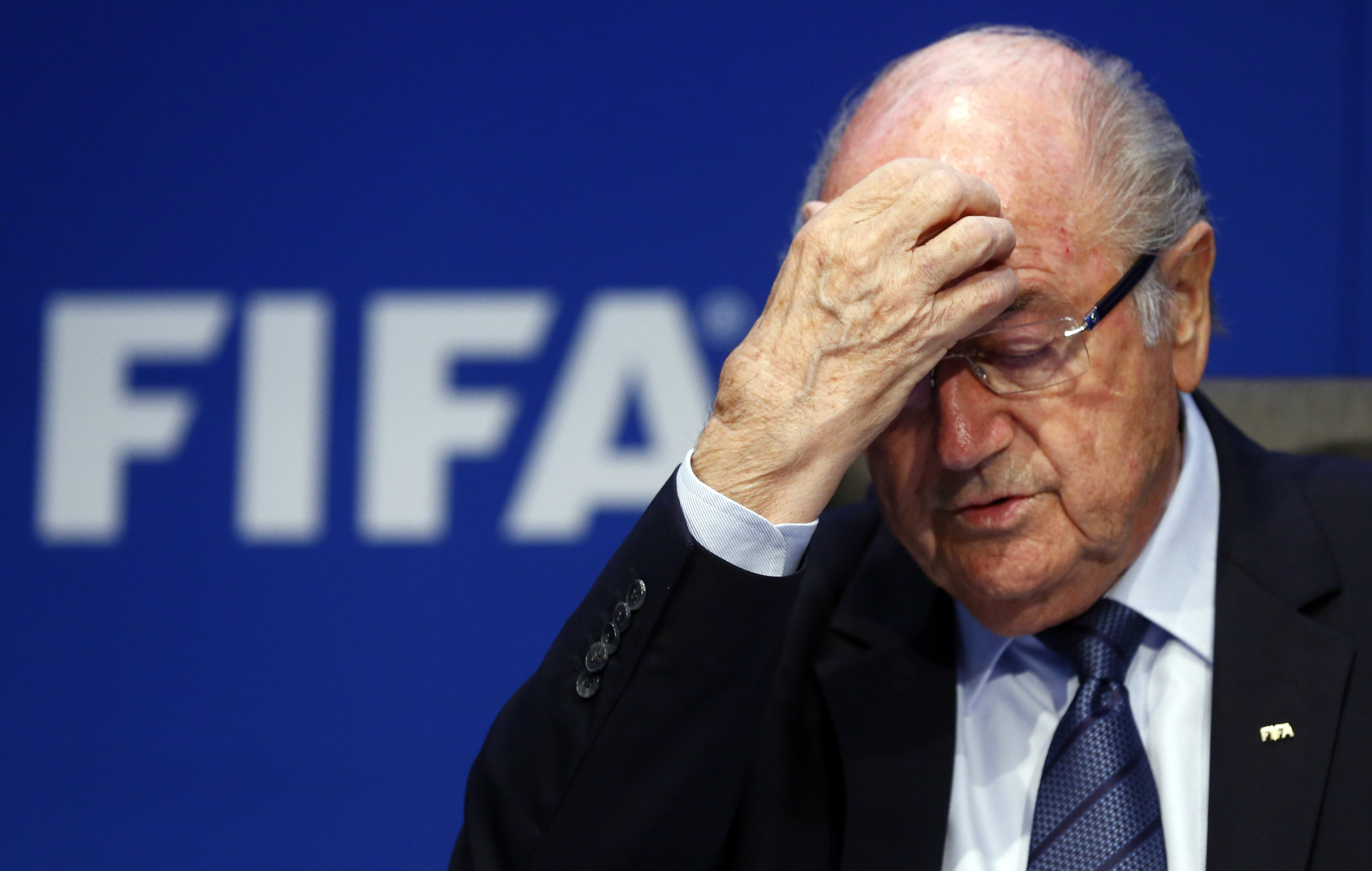Re-elected FIFA President Sepp Blatter gestures during news conference after an extraordinary Executive Committee meeting in Zurich, Switzerland, in a May 30, 2015 file photo. The Coca-Cola Co called on Friday for FIFA's President Sepp Blatter to step down immediately following Swiss authorities saying they were opening a criminal investigation into the head of the world soccer body.    REUTERS/Arnd Wiegmann/Files