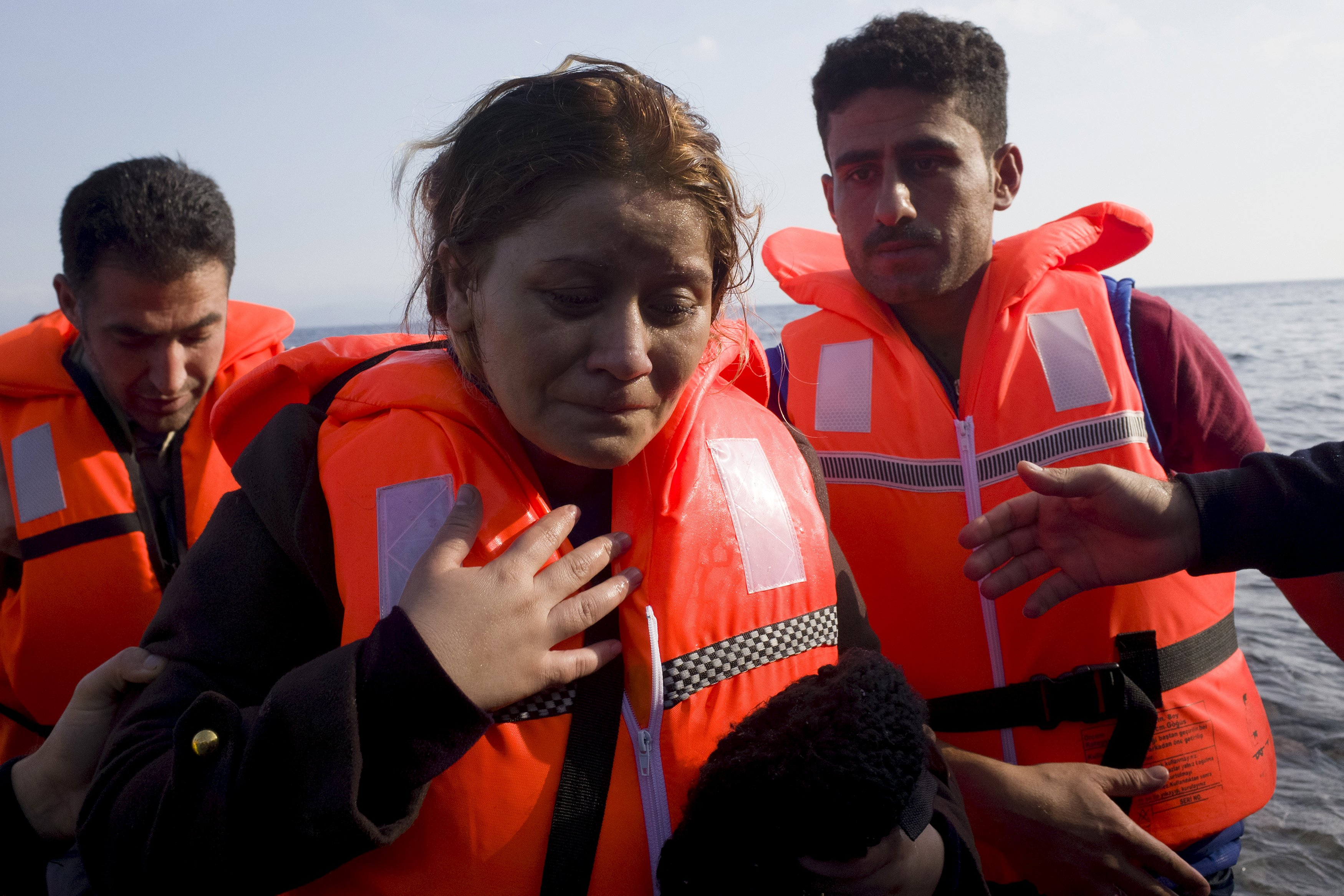 A Syrian refugee reacts following her arrival on an overcrowded dinghy on the Greek island of Lesbos, after crossing a part of the Aegean Sea from the Turkish coast, October 3, 2015. Refugee and migrant arrivals to Greece this year will soon reach 400,000, according to the UN Refugee Agency (UNHCR). REUTERS/Dimitris Michalakis
