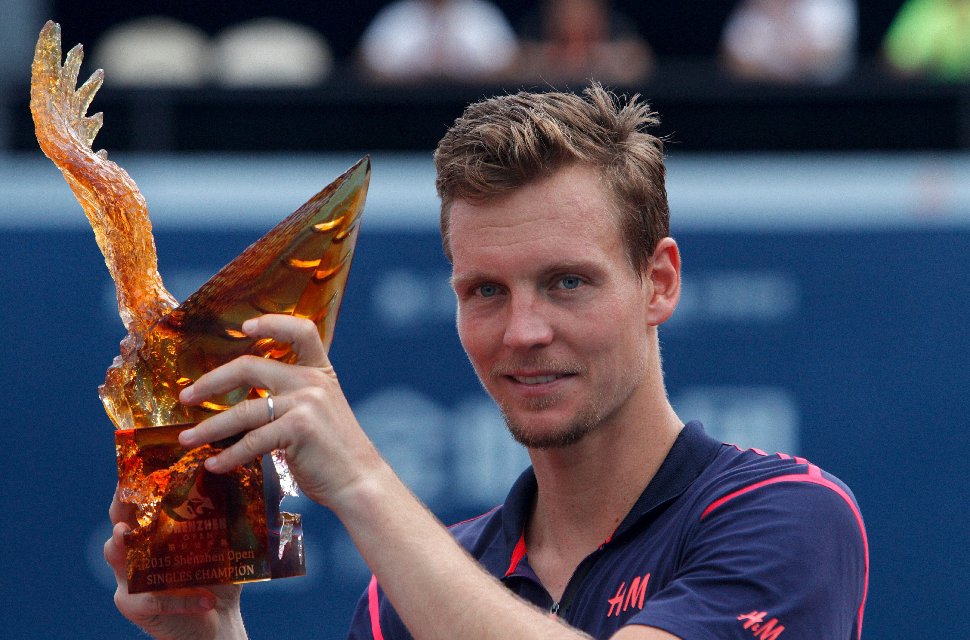 Tomas Berdych of the Czech Republic celebrates winning in final match of Shenzhen open tennis tournament against Guillermo Garcia-Lopez of Spain, Guangdong province, October 5, 2015. Tomas Berdych captured his 11th career ATP title, and his first this year, by beating Spain's Guillermo Garcia-Lopez 6-3 7-6 (7) in a rain-delayed Shenzhen Open final on Monday. REUTERS/Alex Lee