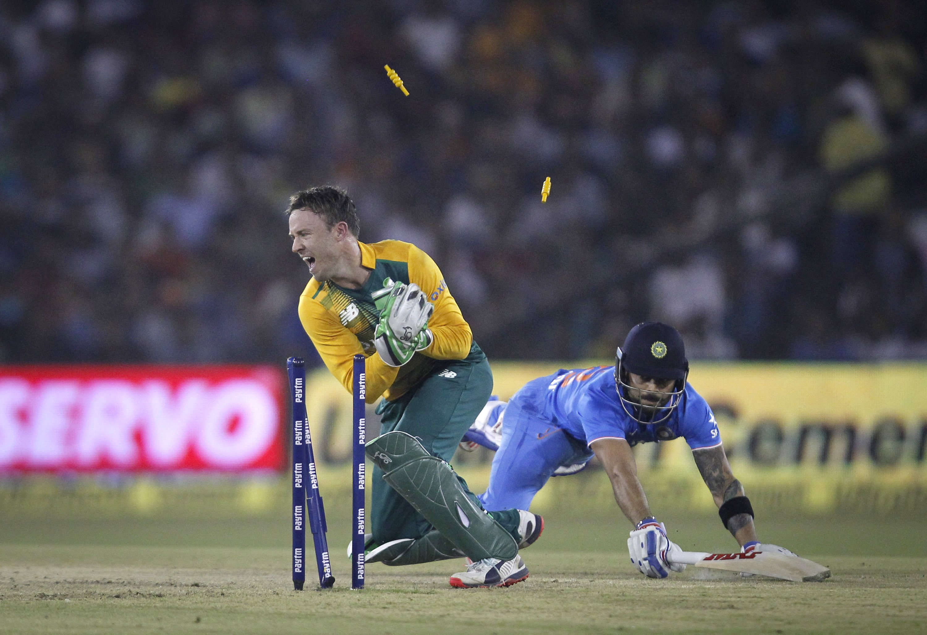 India's Virat Kohli dives to make the crease as he is run out by South Africa's AB de Villiers during their second Twenty20 cricket match in Cuttack, India, October 5, 2015. Photo: Reuters
