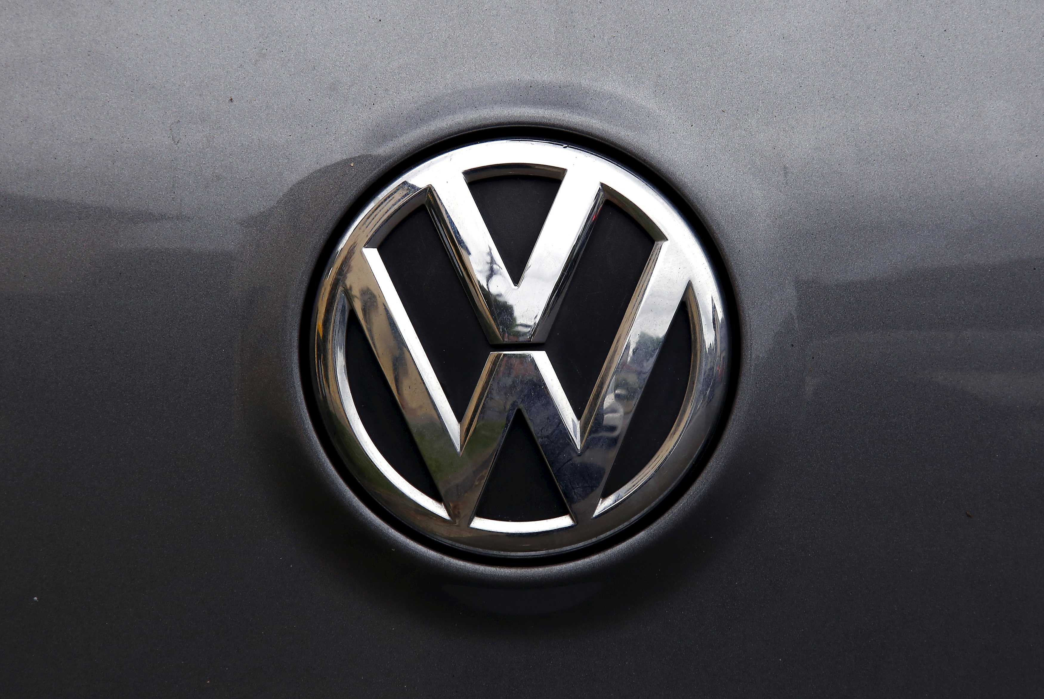 A Volkswagen logo is seen on one of the German automaker's cars in a street in Sydney, Australia, October 8, 2015. Photo: Reuters