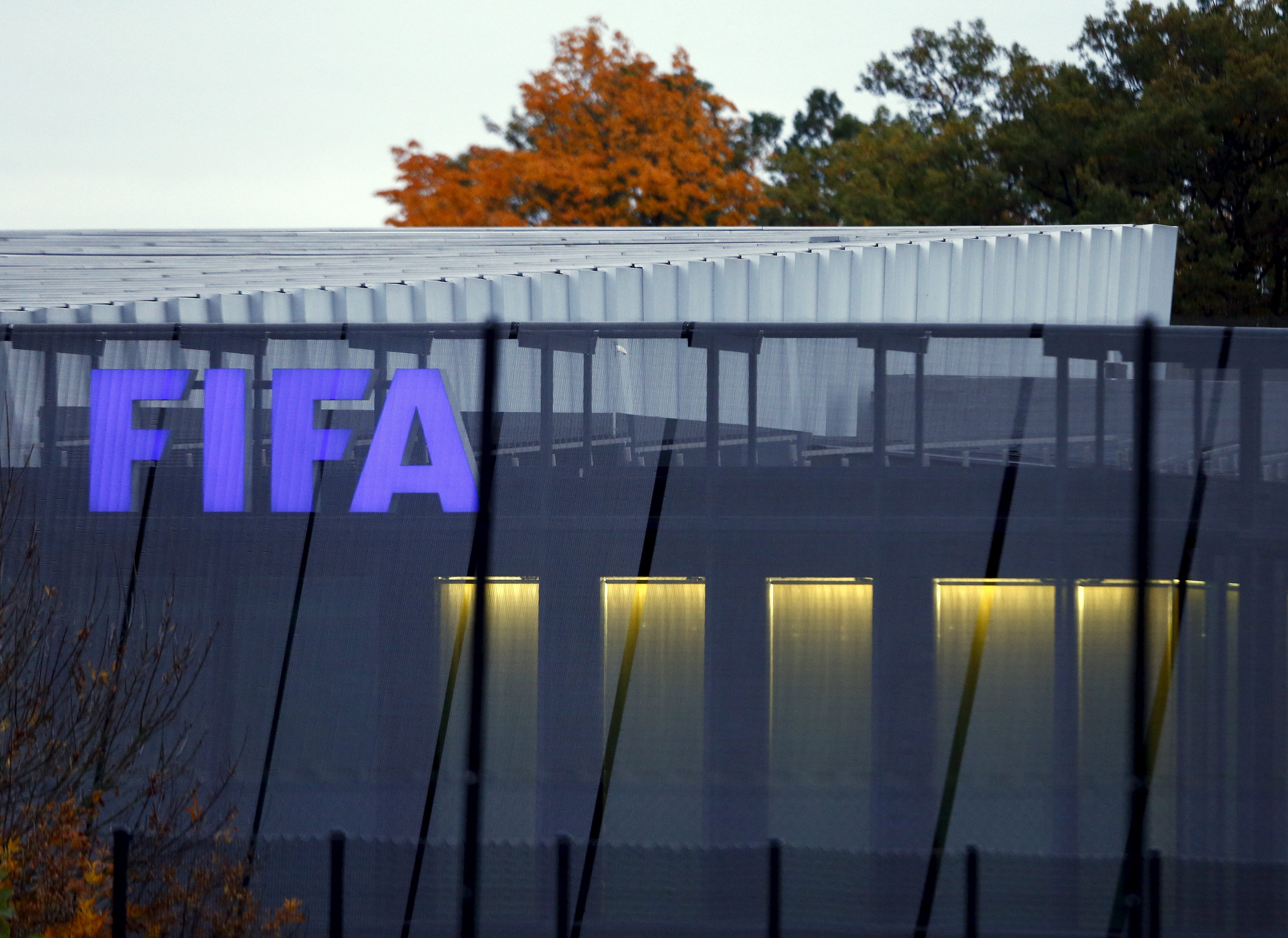 The FIFA logo is seen in the early morning at their headquarters in Zurich October 8, 2015. FIFA president Sepp Blatter faces an imminent 90-day suspension from football if the governing body's ethics judge backs a prosecutor's recommendation, a close friend and former advisor to Blatter told Reuters on October 7, 2015. REUTERS/Arnd Wiegmann