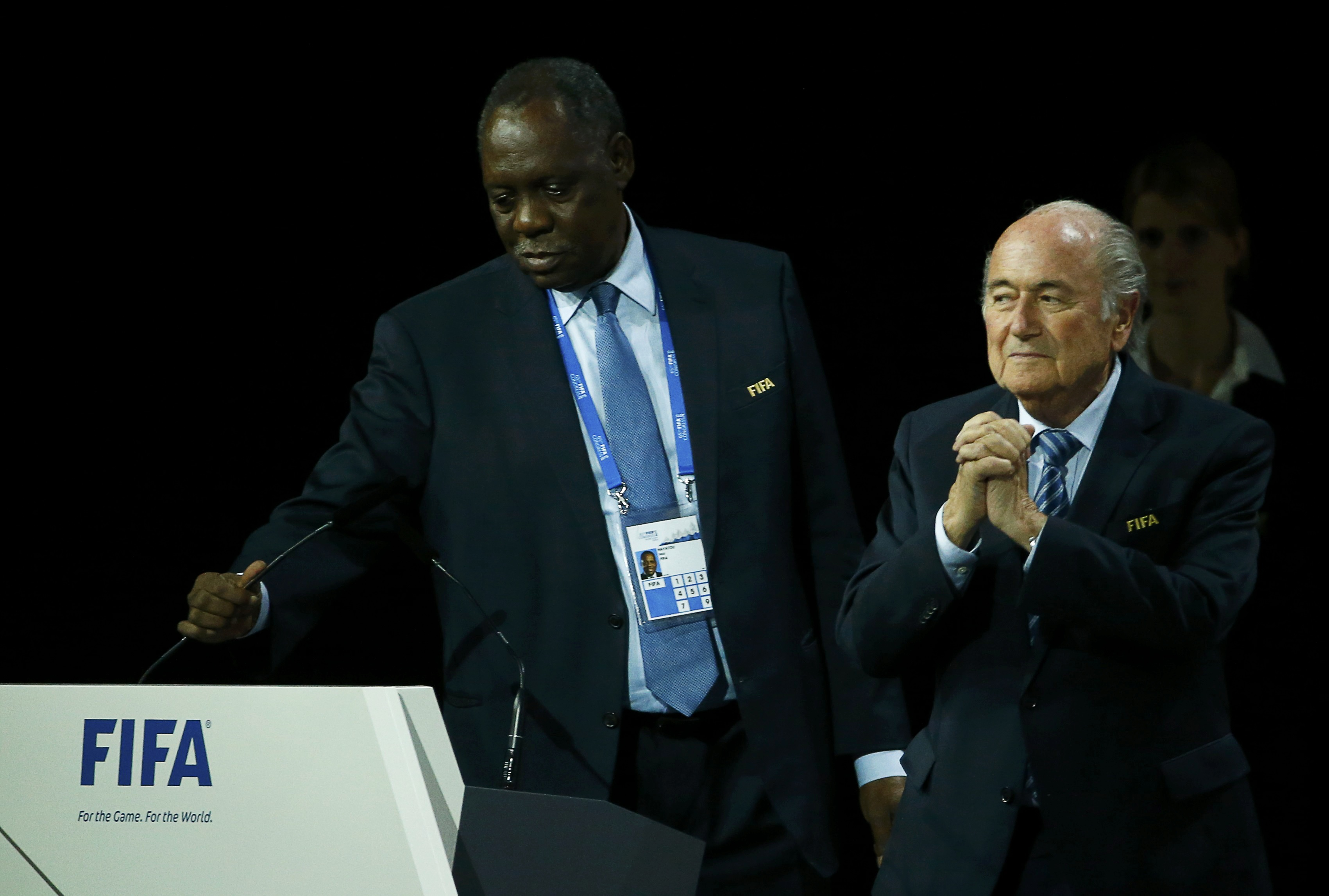 Issa Hayatou (L), Senior Vice President of the FIFA stands with FIFA President Sepp Blatter after he was re-elected at the 65th FIFA Congress in Zurich, Switzerland, in this May 29, 2015 file photo. Issa Hayatou of Cameroon will take over as acting FIFA President after Sepp Blatter was provisionally suspended for 90 days on Thursday by an ethics committee, football's governing body confirmed in a statement. Hayatou, the president of the Confederation of African Football (CAF), would take over, in accordance with FIFA statutes, as the longest-serving vice-president on FIFA's executive committee, the statement said. REUTERS/Ruben Sprich/Files