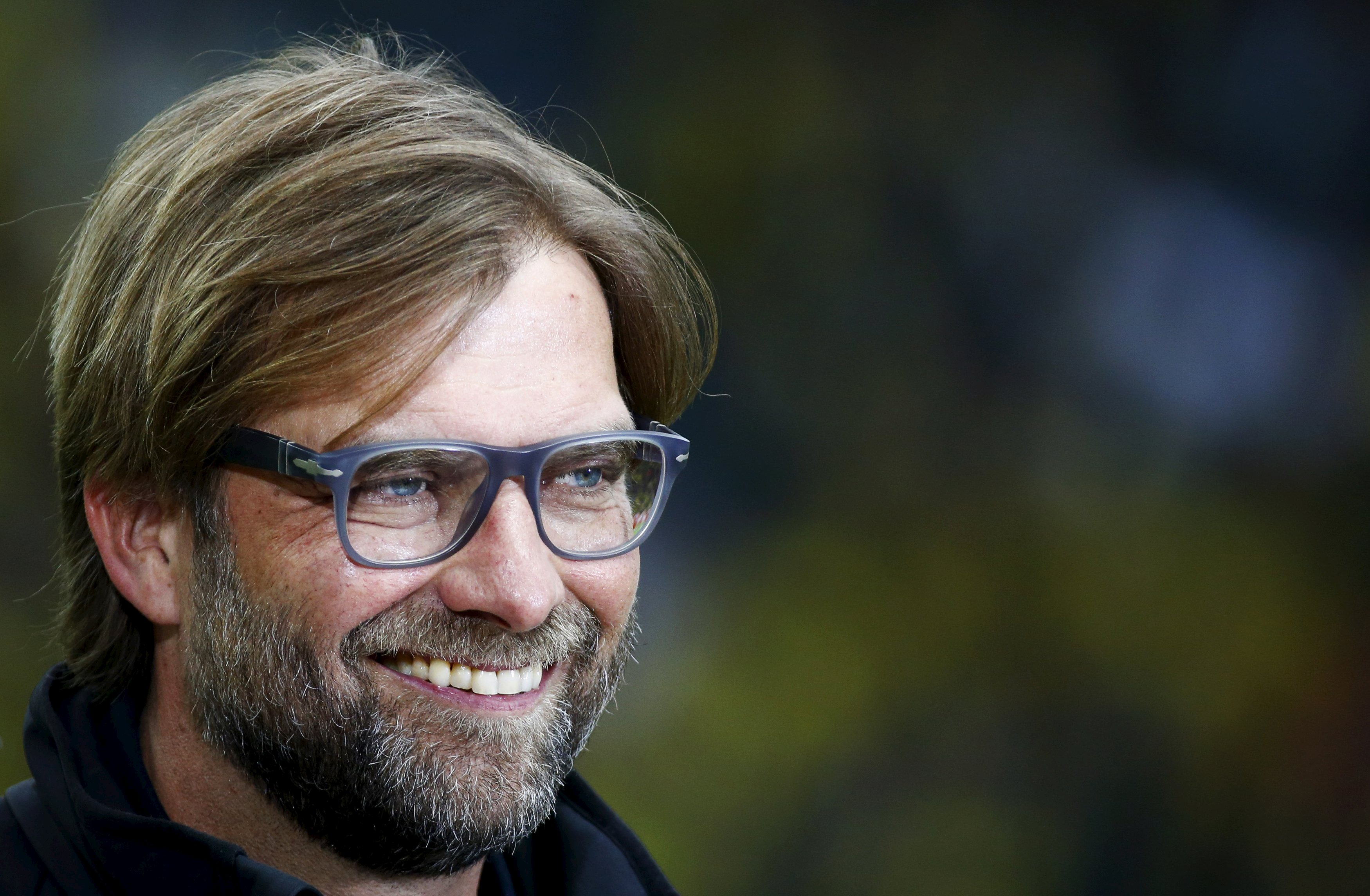 Juergen Klopp, then coach of Borussia Dortmund, smiles before their German Cup (DFB Pokal) final soccer match against Bayern Munich in Berlin, in this May 17, 2014 file picture. Liverpool have named former Borussia Dortmund coach Juergen Klopp as manager to replace the sacked Brendan Rodgers, the Premier League club said in a statement on October 8, 2015. The 48-year-old German has signed a deal to take over at Anfield and will be presented at a news conference on Friday.    REUTERS/Michael Dalder/Files