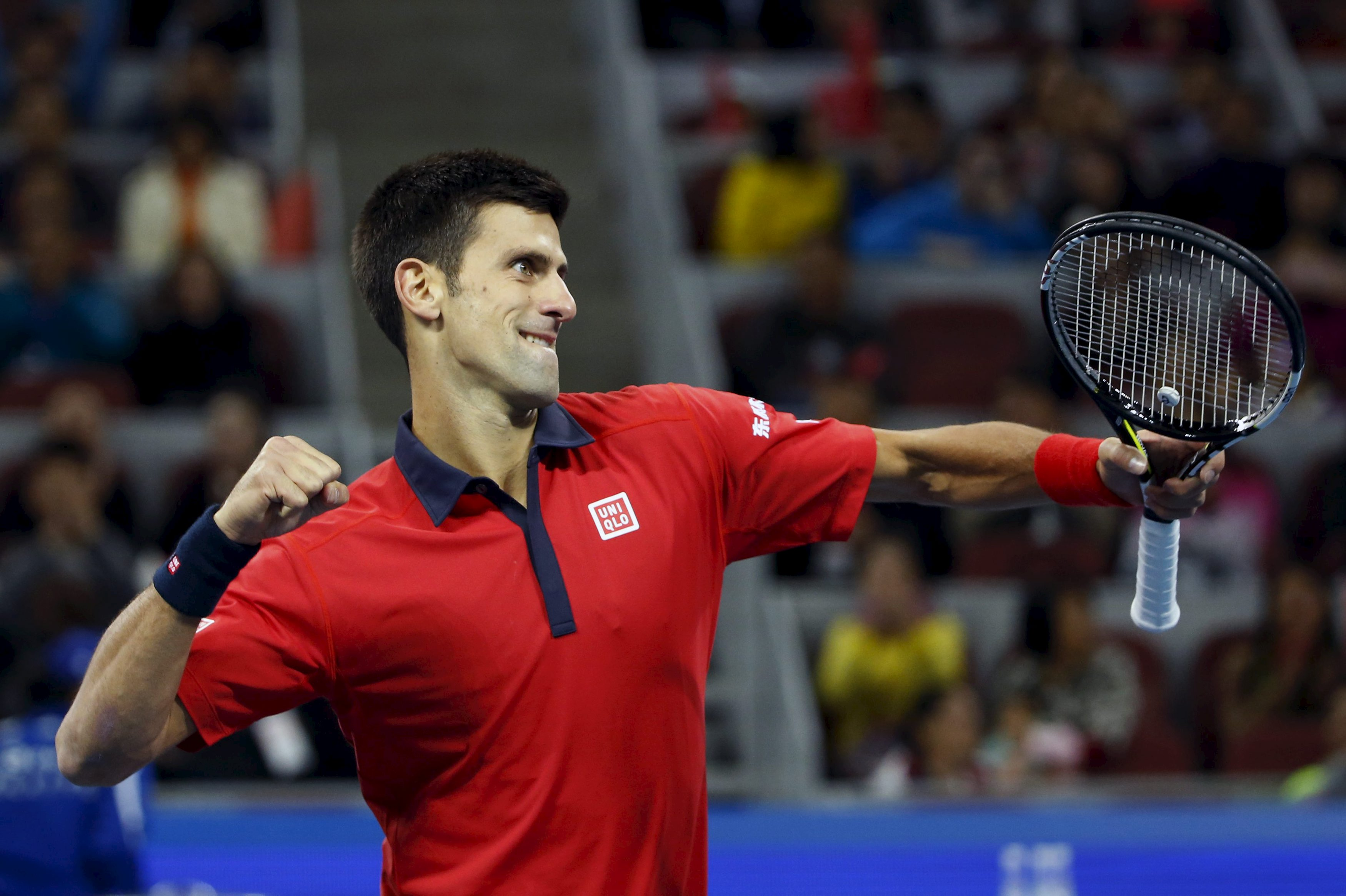 Novak Djokovic of Serbia reacts after winning a point against David Ferrer of Spain during their men's singles semifinal match at the China Open tennis tournament in Beijing, China, October 10, 2015. Rafa Nadal will take on world number one Djokovic in the China Open final after the multiple grand slam champions bludgeoned their way to straight-sets wins on Saturday. REUTERS/Kim Kyung-Hoon