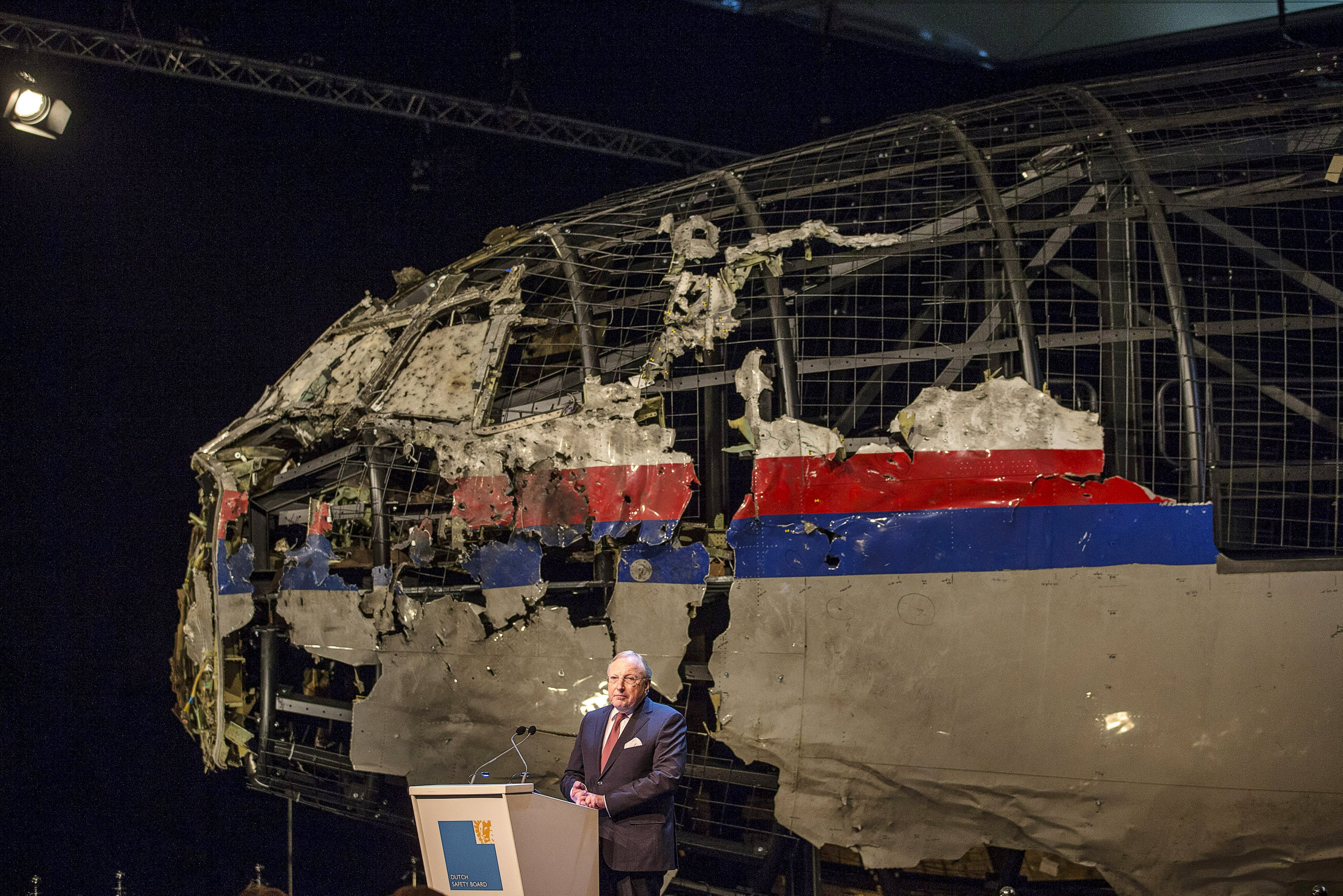 Tjibbe Joustra, chairman of the Dutch Safety Board, presents the final report into the crash of July 2014 of Malaysia Airlines flight MH17 over Ukraine in Gilze Rijen, the Netherlands, October 13, 2015. The Dutch Safety Board, issuing long-awaited findings on Tuesday of its investigation into the crash of a Malaysian passenger plane over eastern Ukraine, is expected to say it was downed by a Russian-made Buk missile but not say who was responsible for firing it. Buk manufacturer Almaz-Antey scheduled a separate press conference on Tuesday at which it may attempt to discredit the Safety Board findings. REUTERS/Michael Kooren      TPX IMAGES OF THE DAY