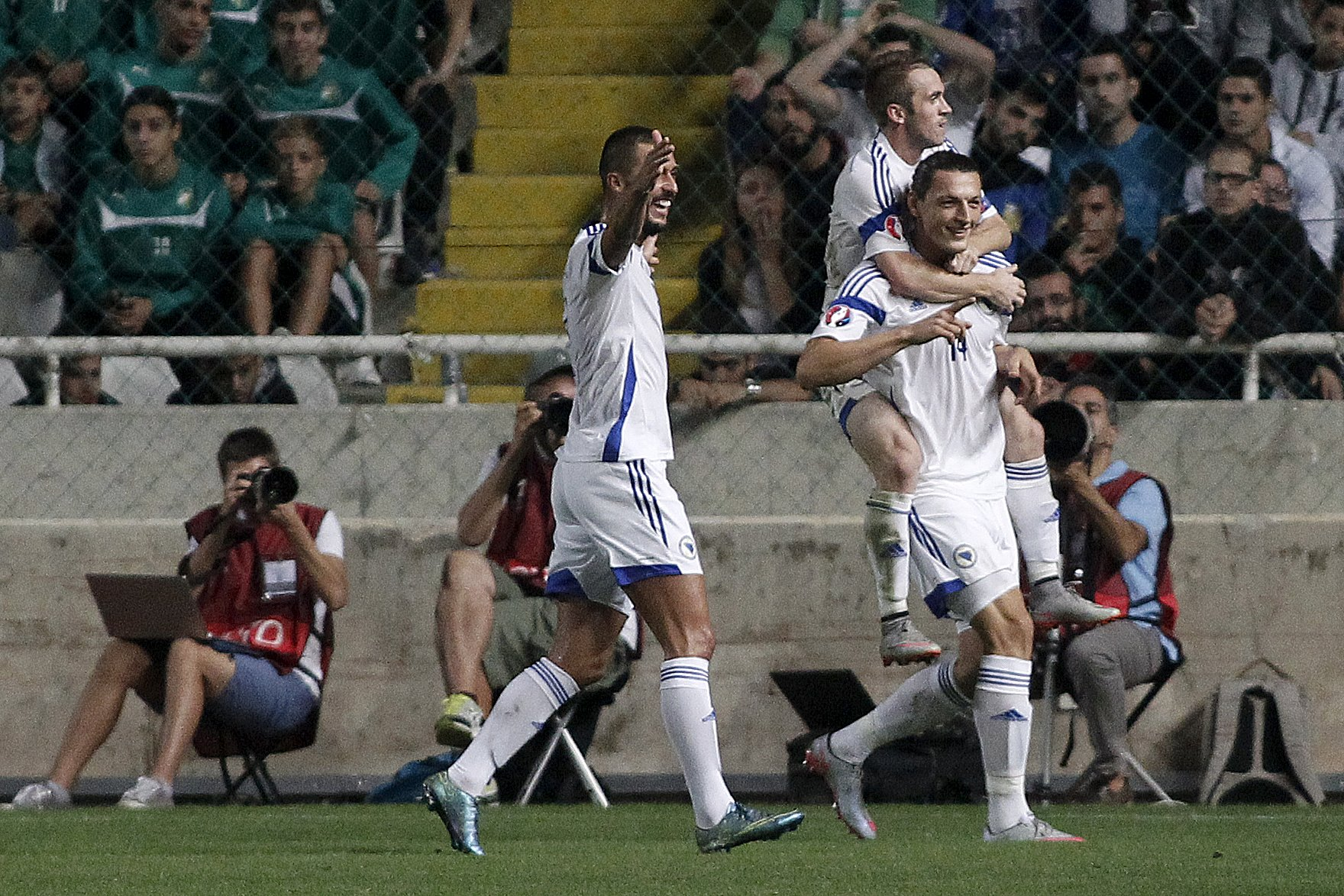Bosnia's Milan Djuric (C) celebrates a goal  with teammates during the Euro 2016 group B qualification match against Cyprus at the GSP stadium in Nicosia, Cyprus October 13, 2015. REUTERS/Yiannis Kourtoglou