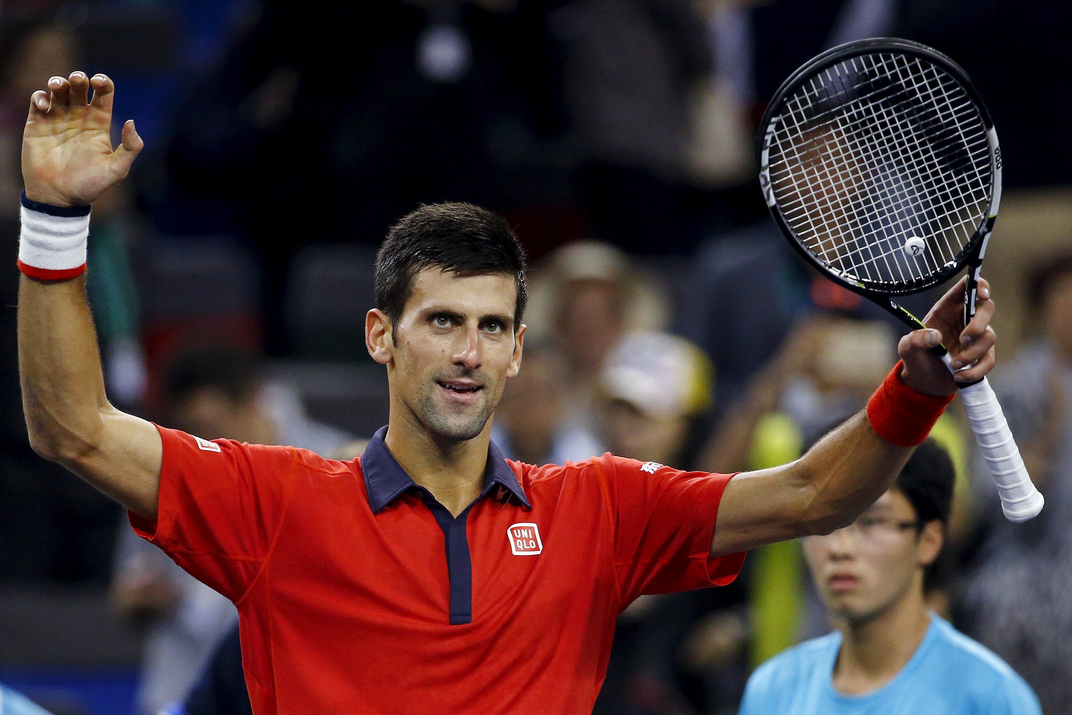 Novak Djokovic of Serbia celebrates after beating Andy Murray of Britain in their men's singles semi-final match at the Shanghai Masters tennis tournament in Shanghai, China, October 17, 2015. REUTERS/Damir Sagolj