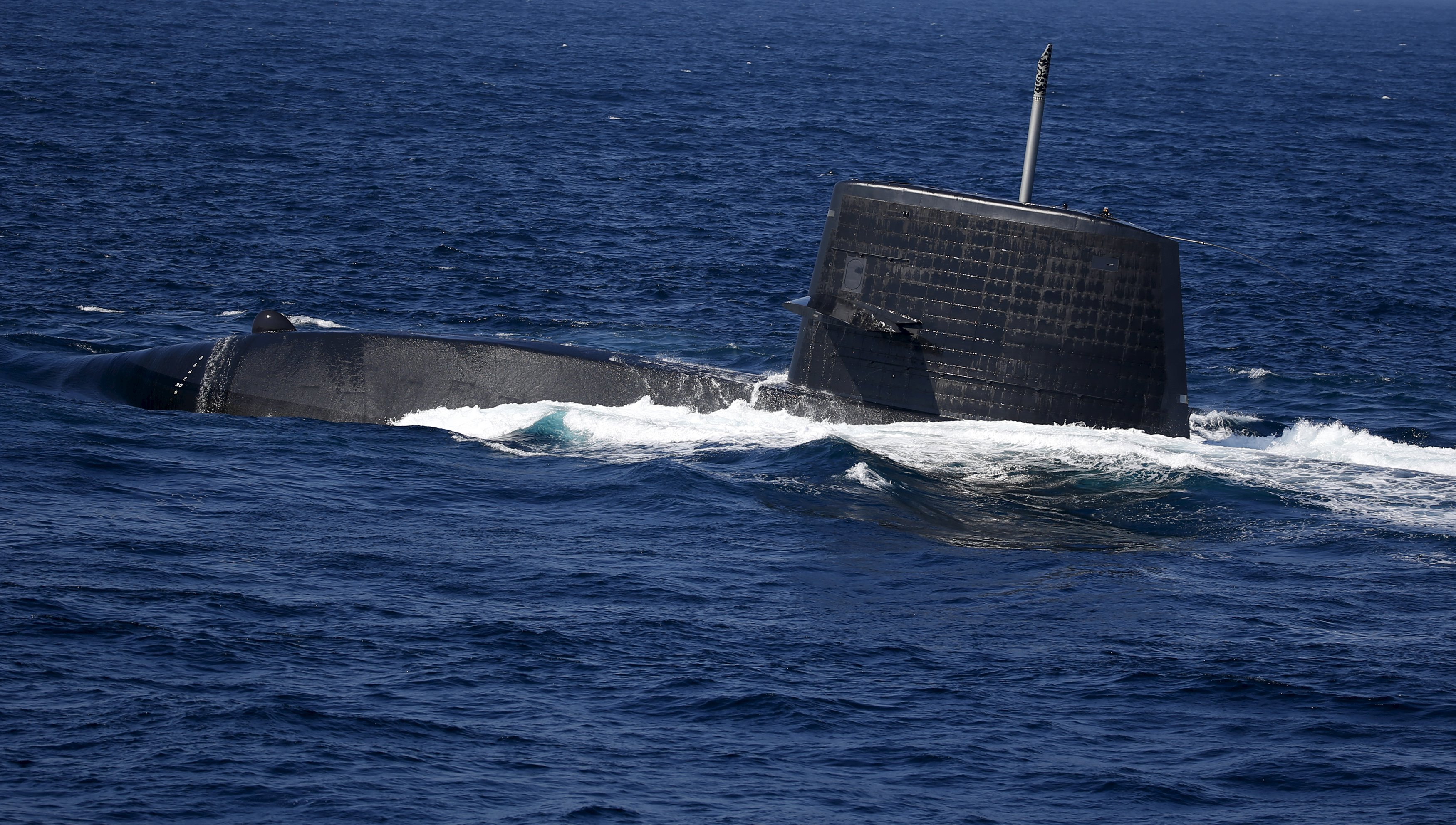 The Uzushio submarine of the Japan Maritime Self-Defense Force (JMSDF) bursts to the surface during a fleet review at Sagami Bay, off Yokosuka, south of Tokyo October 18, 2015. Photo: Reuters