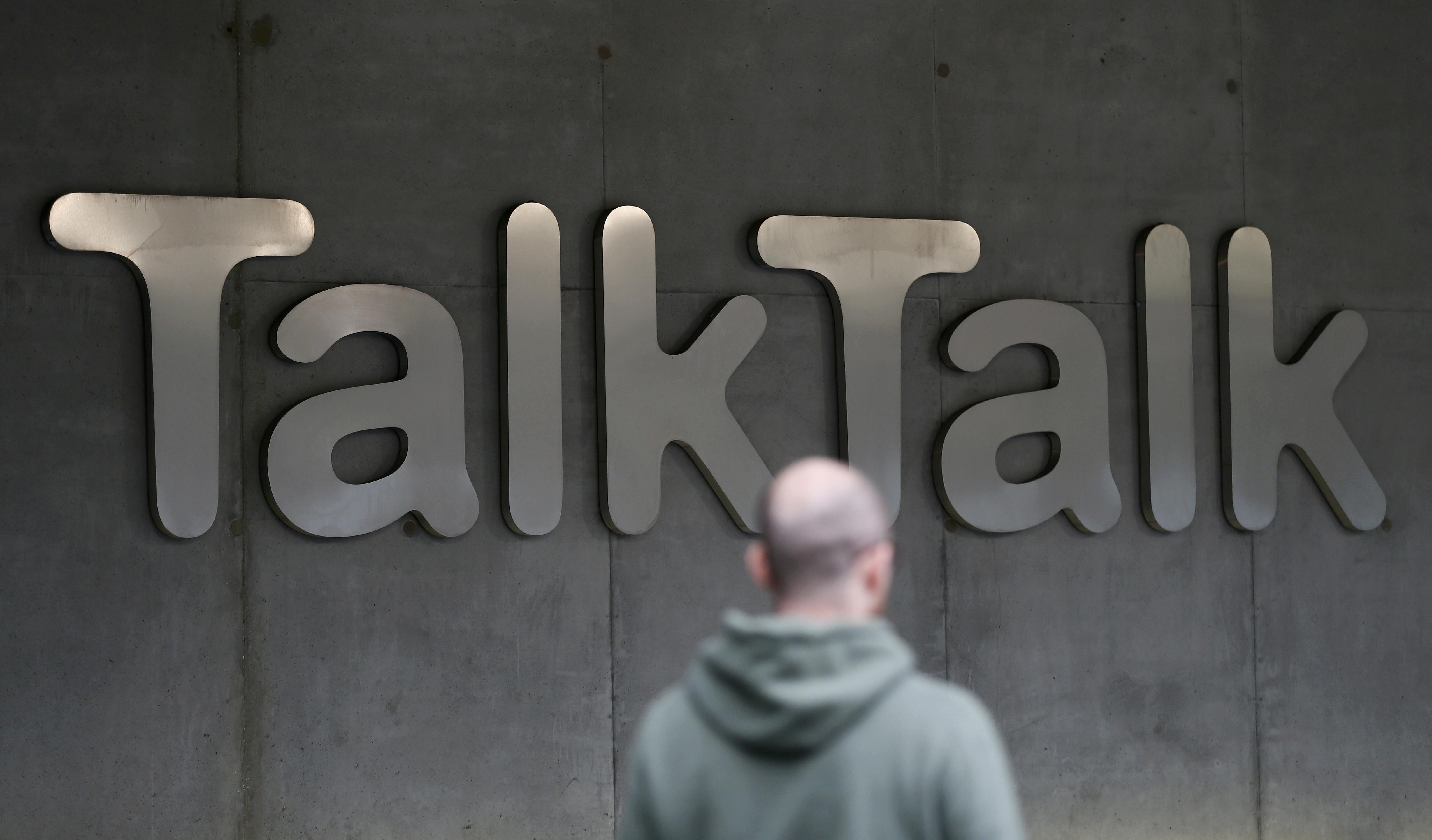 A man walks past a company logo outside a TalkTalk building in London, Britain October 23, 2015. Photo: Reuters