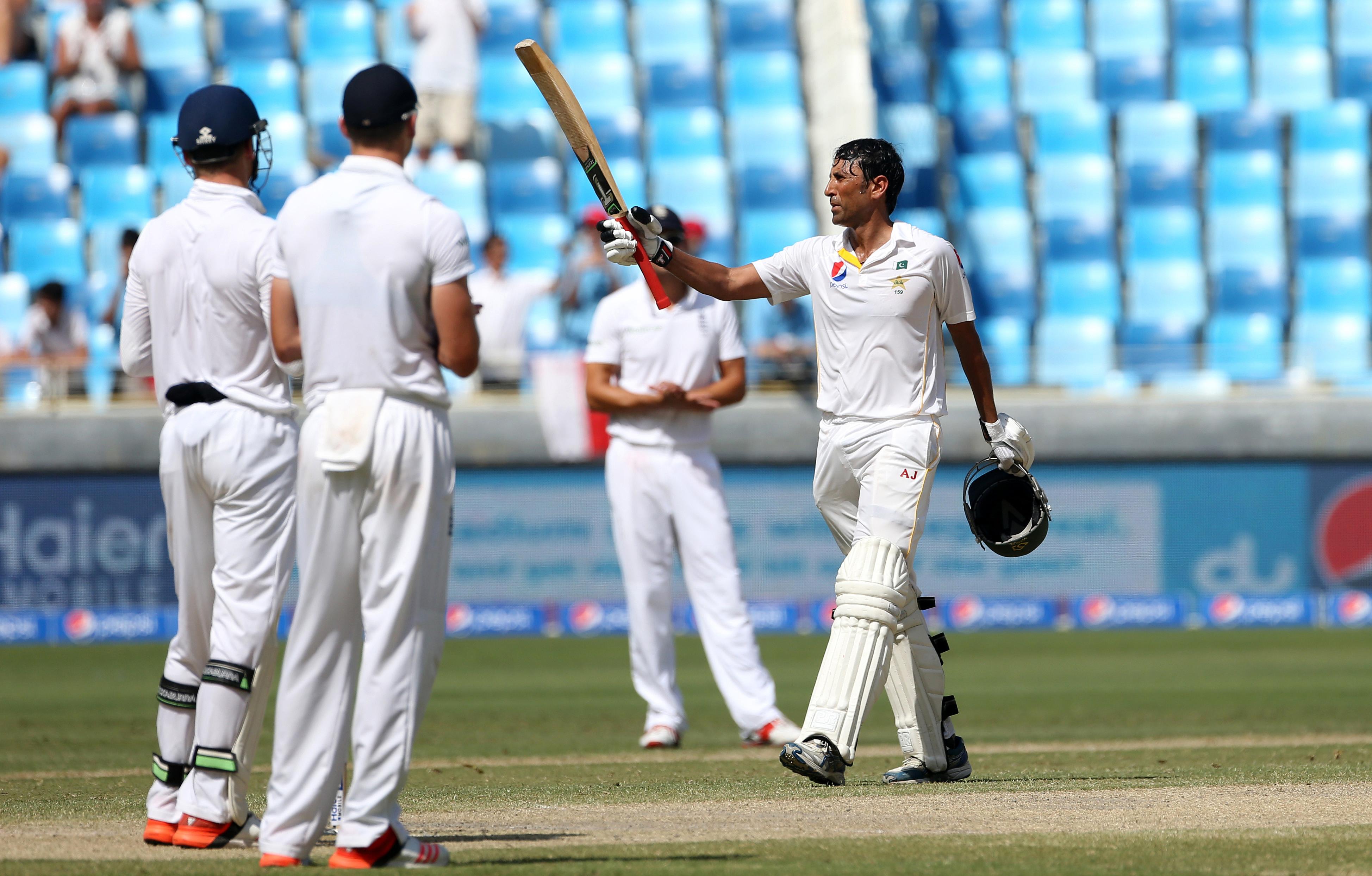 Pakistan's Younis Khan (right) celebrates scoring a century. Photo: Action Images via Reuters