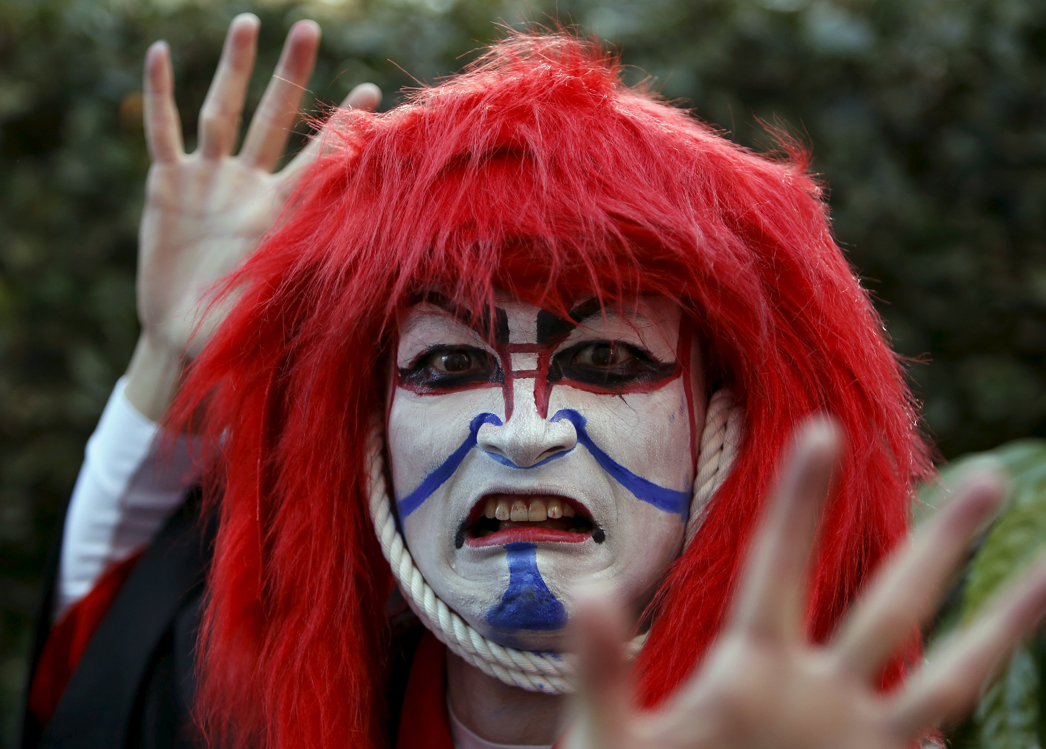 A participant in costume poses for a picture after a Halloween parade in Kawasaki, south of Tokyo, Japan October 25, 2015. Photo: Reuters