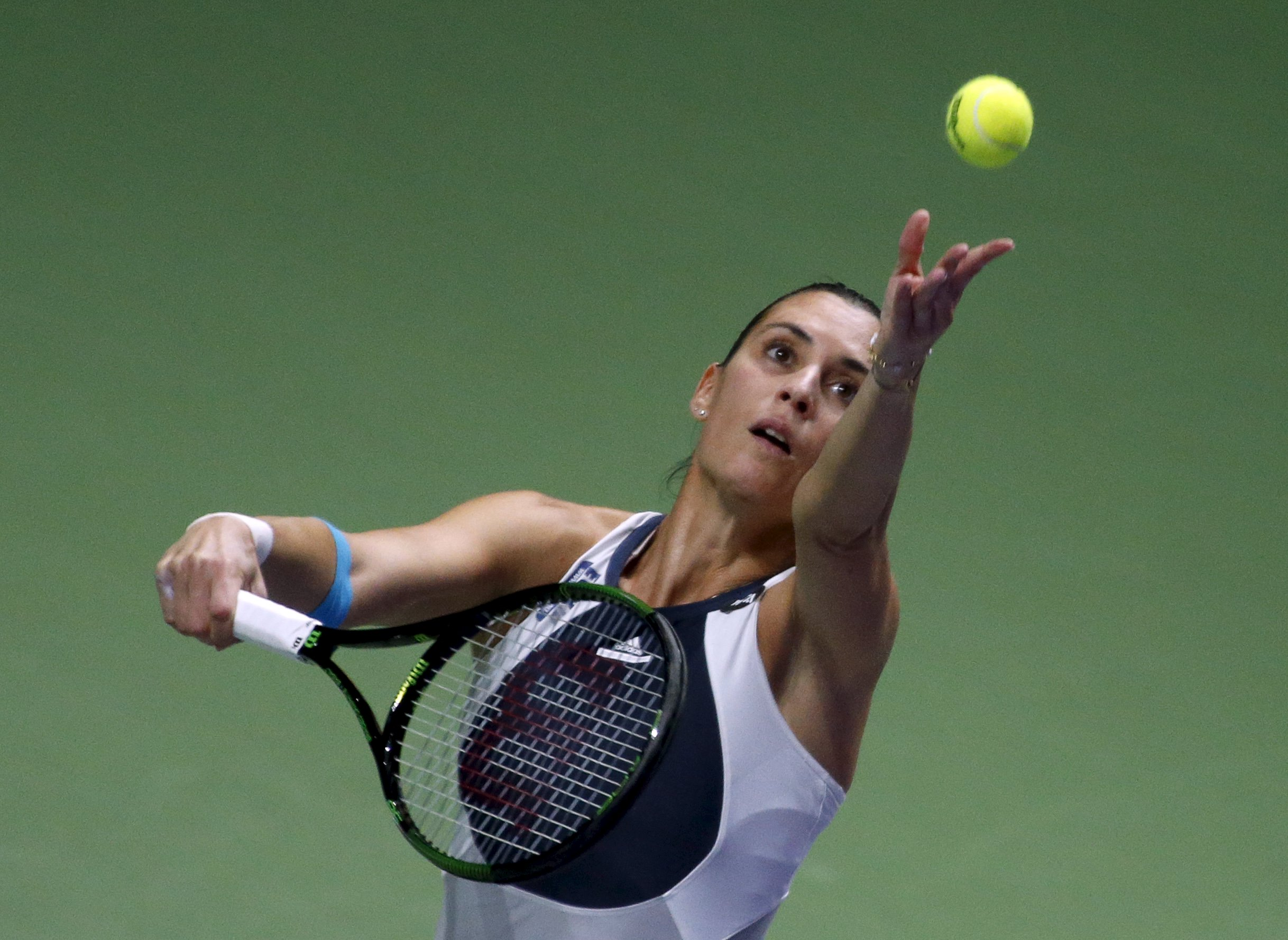 Flavia Pennetta of Italy serves to Maria Sharapova of Russia during their women's singles tennis match of the WTA Finals at the Singapore Indoor Stadium October 29, 2015. REUTERS/Edgar Su