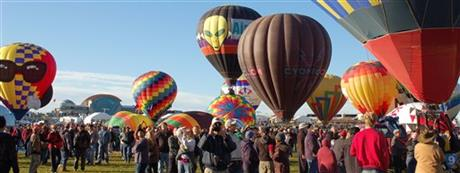 In this Oct. 8, 2011 file photo, spectators take photos of the hot air balloons at the Albuquerque International Balloon Fiesta before take off. It's that time of year again when hundreds of thousands of visitors from around the world descend upon New Mexico to watch as a mass of hot air balloons takes to the sky every morning for nine straight days. Albuquerque's International Balloon Fiesta is among the world's most photographed events.Photo AP