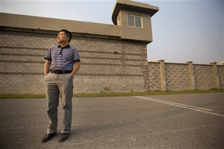 In this Sept. 16, 2015 photo, Chinese journalist Liu Hu poses for a portrait as he stands outside the detention center where he was held on the outskirts of Beijing. Liu, who was ultimately cleared when prosecutors decided not to bring any charges against him, recounted in an interview with the Associated Press how Chinese police - in cooperation with the state propaganda machine - try to draw out confessions and air them on state television to shame suspects and sway public perceptions ahead court trials. Photo:AP