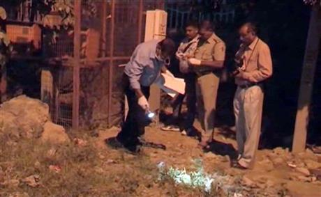 In this image made from video, police collect evidence in the playground where an alleged rape of a two-year-old girl took place in New Delhi, early Saturday, Oct. 17, 2015. Photo:AP