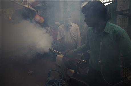 In this Wednesday, Oct. 7, 2015 photo, a municipality worker uses a machine to fog for mosquitoes at a neighborhood in New Delhi, India.c Photo: AP