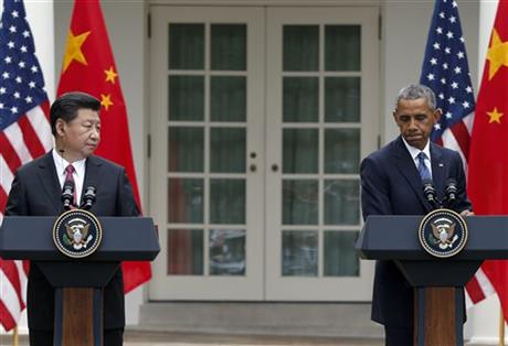 In this Friday, Sept. 25, 2015, file photo, President Barack Obama, right, pauses during a joint news conference with Chinese President Xi Jinping in the Rose Garden of the White House in Washington.  Photo: AP