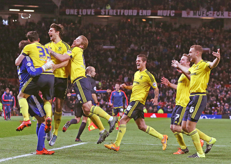 Middlesbrough's Spanish goalkeeper Tomas Mejias (L) is congratulated by Middlesbrough players after saving Ashley Young's penalty in the shoot-out during the English League Cup fourth round football match between Manchester United and Middlesbrough at Old Trafford in Manchester, north west England on October 28, 2015. Middlesbrough won 3-1 on penalties after the game finished 0-0 after extra time. AFP PHOTO / NIGEL RODDISnnnnRESTRICTED TO EDITORIAL USE. NO USE WITH UNAUTHORIZED AUDIO, VIDEO, DATA, FIXTURE LISTS, CLUB/LEAGUE LOGOS OR 'LIVE' SERVICES. ONLINE IN-MATCH USE LIMITED TO 75 IMAGES, NO VIDEO EMULATION. NO USE IN BETTING, GAMES OR SINGLE CLUB/LEAGUE/PLAYER PUBLICATIONS.