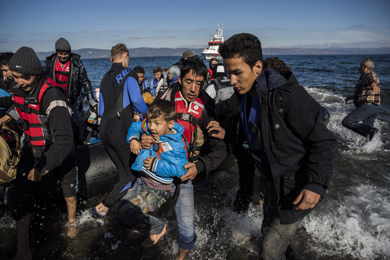 Afghan migrants arrive on the shores of the  Greek island of Lesbos after crossing the Aegean sea from Turkey on an overcrowded dinghy , Tuesday, Oct. 27, 2015. Greeceu0092s government says it is preparing a rent-assistance program to cope with a growing number of refugees, who face the oncoming winter and mounting resistance in Europe. (AP Photo/Santi Palacios)