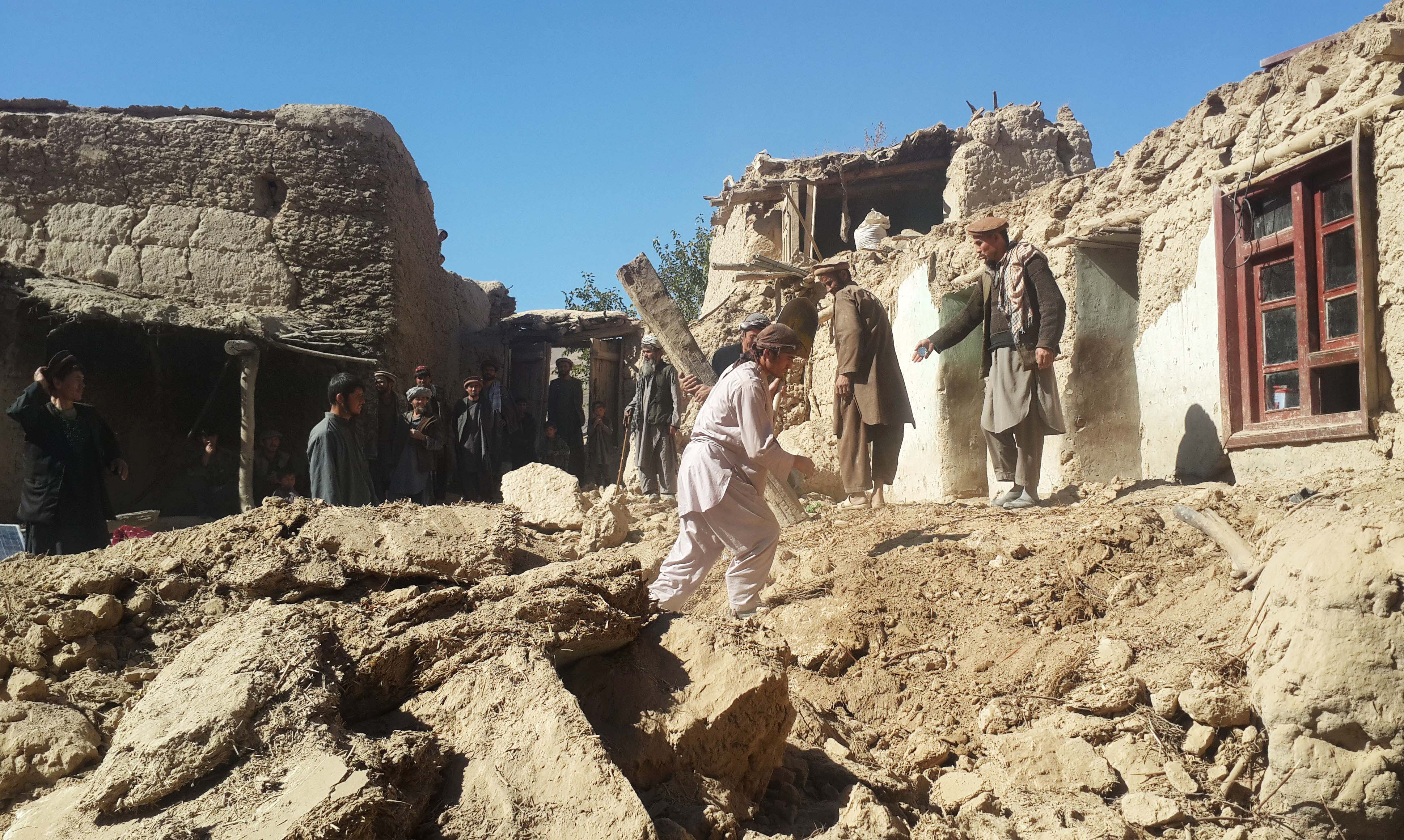 Afghan men carry their belongings after an earthquake in Takhar province, northeast of Kabul, Afghanistan, Tuesday, Oct. 27, 2015. Rescuers were struggling to reach quake-stricken regions in Pakistan and Afghanistan on Tuesday as officials said the combined death toll from the previous day's earthquake rose to more than 300.(AP Photo/Zalmai Ashna)