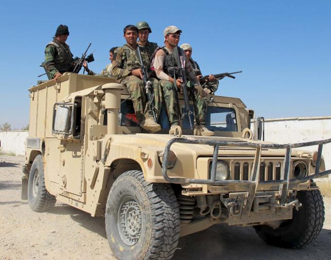 Afghan security forces arrive to fight with Taliban forces in Helmand, Afghanistan October 21, 2015. REUTERS/Stringer